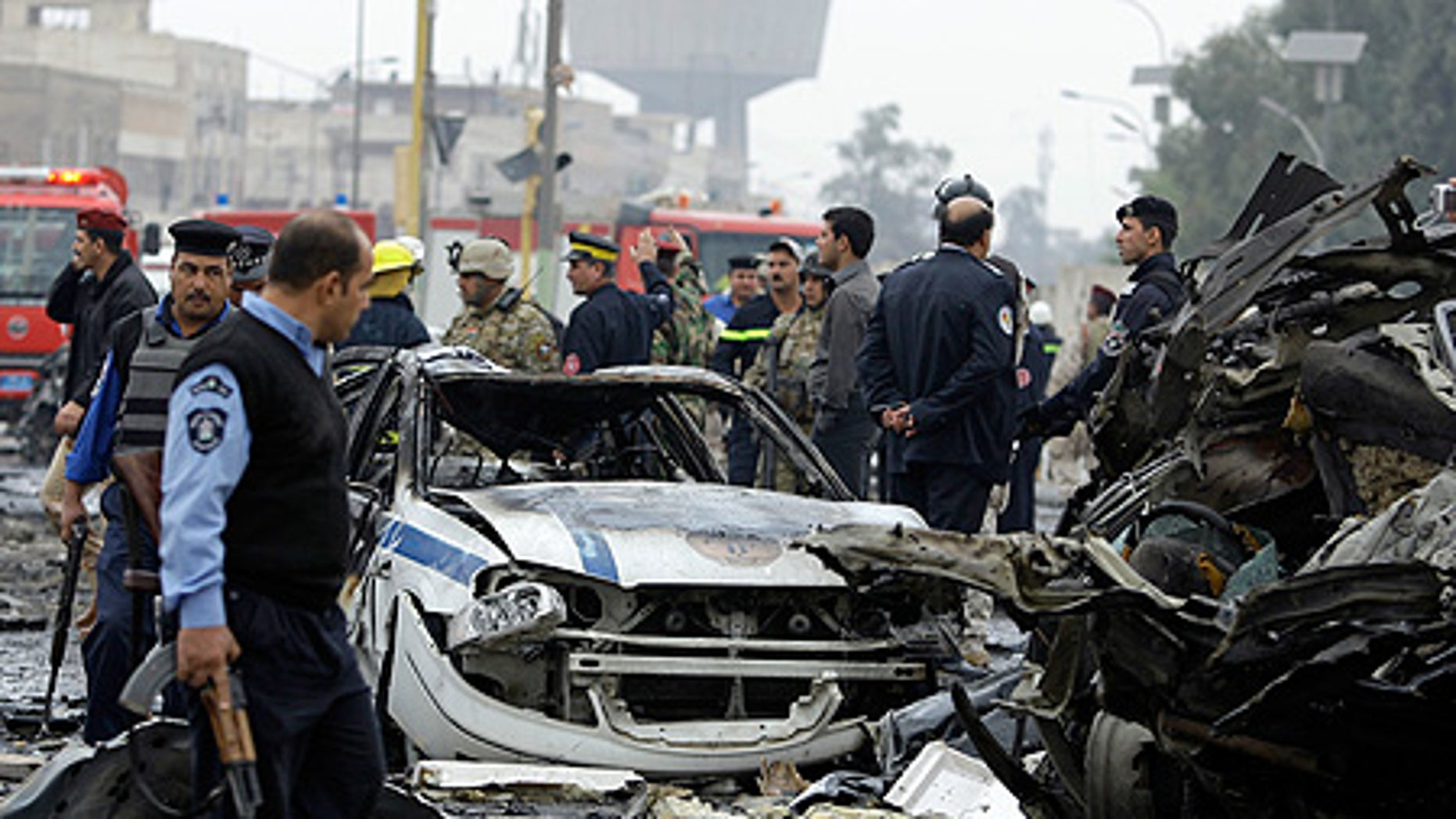 Dec. 8: Iraqi security forces gather at the site of a bomb attack near the Labor Ministry building in Baghdad.