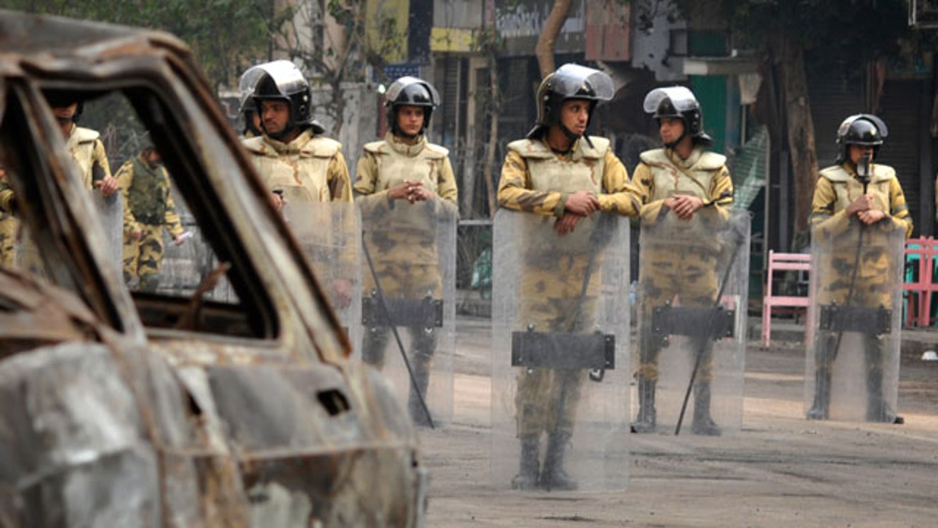 Nov.26, 2011:gyptian soldiers stand guard on the street leading from Tahrir Square to the Interior Ministry in Cairo, Egypt.
