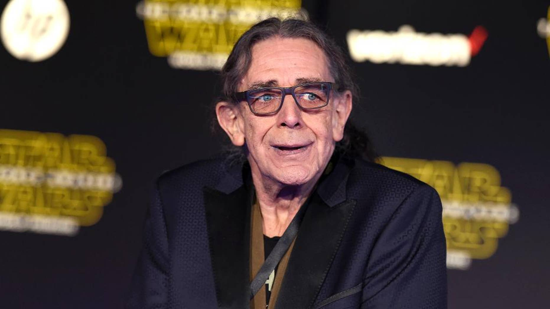 """FILE - In this Dec. 14, 2015, file photo, Peter Mayhew arrives at the world premiere of """"Star Wars: The Force Awakens"""" at the TCL Chinese Theatre in Los Angeles. The actor, who plays Chewbacca in the Star Wars films, agreed to meet """"Chewbacca mom"""" Candace Parker in a letter read by James Corden's on Monday's """"Late Late Show."""" (Photo by Jordan Strauss/Invision/AP, File)"""