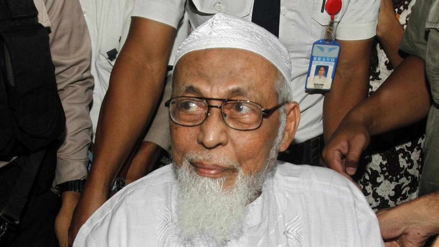 """FILE - In this Wednesday, Feb. 29, 2012 file photo, Indonesian militant cleric Abu Bakar Bashir arrives at a hospital to undergo medical treatment, in Jakarta, Indonesia. A lawyer for the spiritual leader of the militants who carried out the 2002 Bali bombings urges Indonesian authorities to end his """"inhumane"""" treatment in prison, saying that Bashir has been confined to a tiny isolation cell in the wake of the Jan. 14 suicide bombings in the Indonesian capital Jakarta. (AP Photo/Tatan Syuflana, File)"""