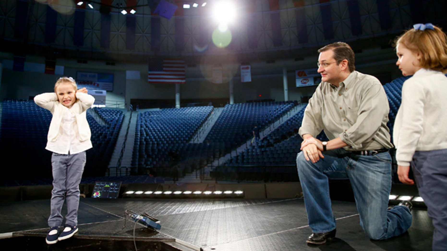 Caroline Cruz, 6, pretends to react to noise as Sen. Ted Cruz, R-Texas, tells her and her sister, Catherine, 4, right, how loud and crowded it will be for Cruz's Monday morning speech where he is expected to launch his campaign for U.S. president, during a walk-through on stage at Liberty University on Sunday, March 22, 2015 in Lynchburg, Va. Cruz will be the first major candidate in the 2016 race for president. (AP Photo/Andrew Harnik)