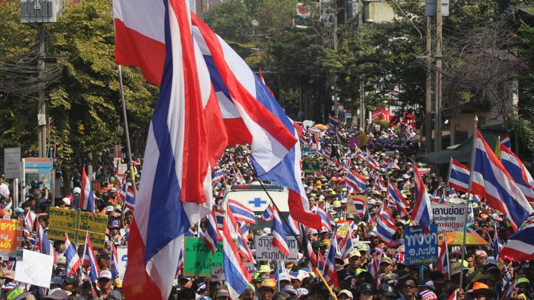 FILE - In this Jan. 18, 2014 file photo, Thai anti-government protesters march on a street during a rally in Bangkok, Thailand. Thailand's military-installed prime minister defended a new law that places tight restrictions on public gatherings and warned Thursday, Aug. 13, 2015 it will be strictly enforced. Human rights groups have voiced concern about the Public Assembly Act, which took effect Thursday, and its stiff penalties.  (AP Photo/Sakchai Lalit, File)