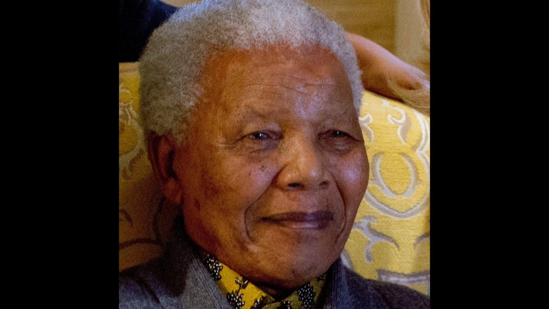 FILE -  This photo taken Monday Aug. 6, 2012 shows former South African President Nelson Mandela when he met with US Secretary of State Hillary Rodham Clinton, unseen, at his home in Qunu, South Africa. Mandela on Friday, Dec 14 2012  entered the seventh day of a hospital stay for a lung infection as questions grow about where he is receiving treatment. The 94-year-old patriarch of South Africa's democracy has been hospitalized since Saturday, first undergoing tests and later being diagnosed with the ailment. (AP Photo/Jacquelyn Martin, Pool, File)