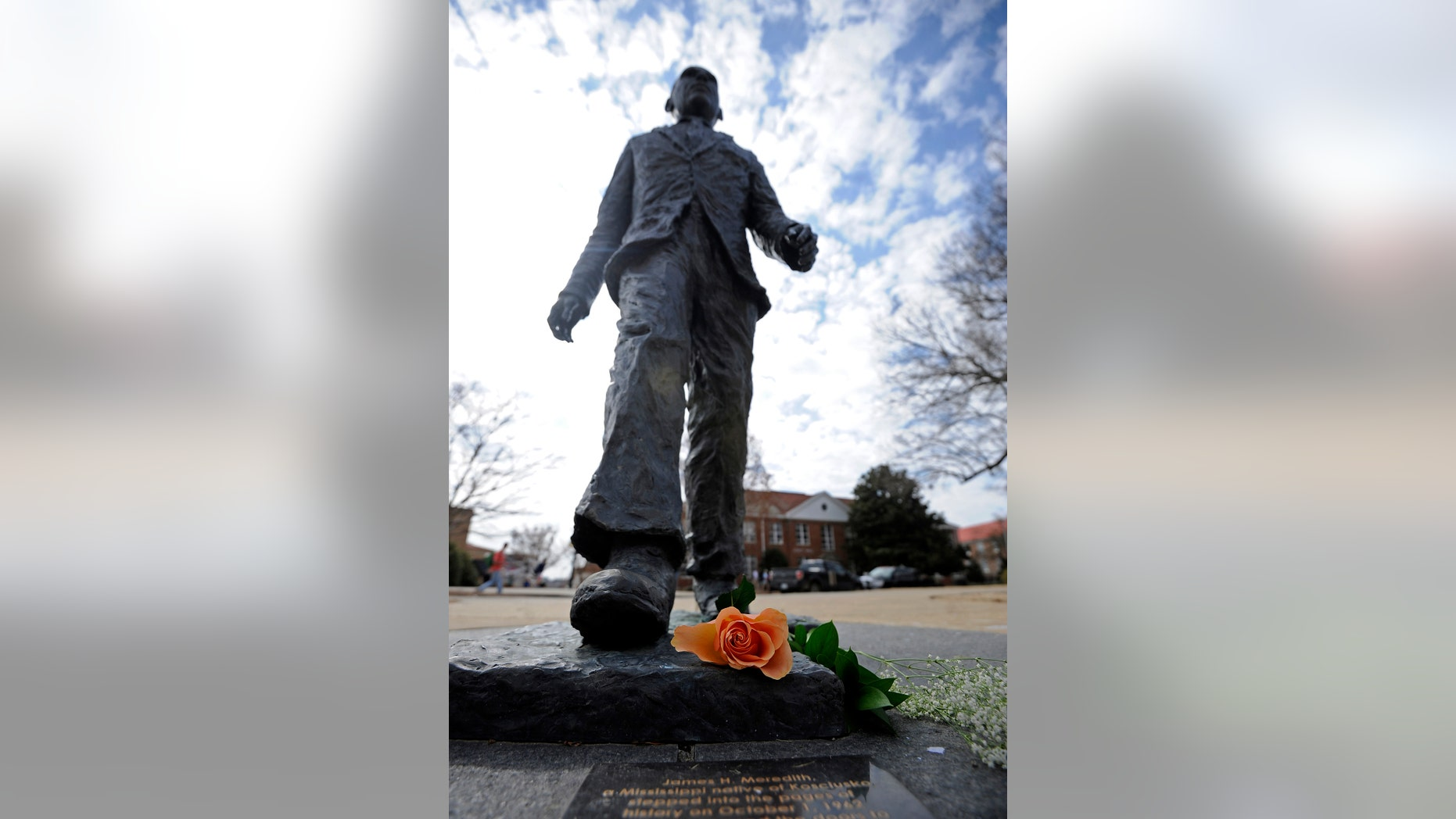 A flower is seen on the James Meredith statue at the University of Mississippi in Oxford, Miss., Tuesday, Feb. 18, 2014.  Campus police at the University of Mississippi are checking video surveillance footage in the area around a statue of James Meredith that was found sullied Sunday morning.  (AP Photo/The Daily Mississippian, Thomas Graning)