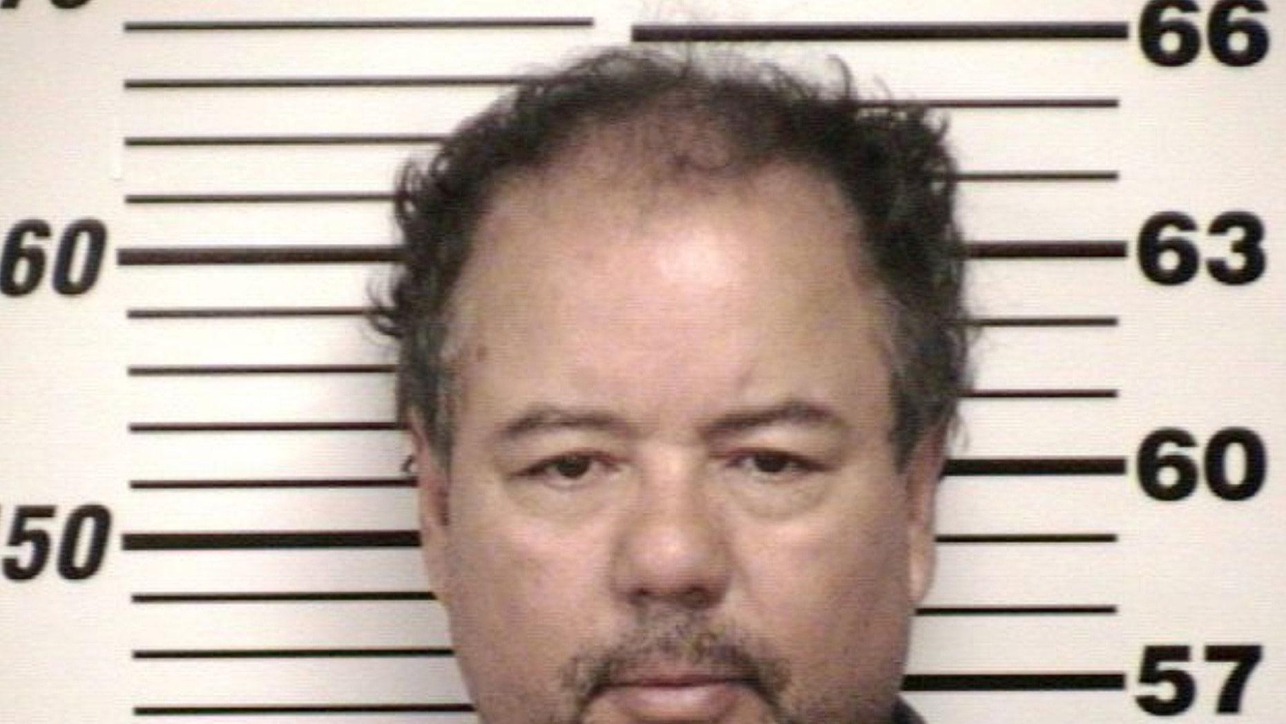 FILE - This undated file photo provided by Cuyahoga County Jail shows Ariel Castro. Cleveland officials are trying to keep Castro's house, where three women were imprisoned for a decade, intact until his trial is concluded. (AP Photo/Cuyahoga County Jail, File)