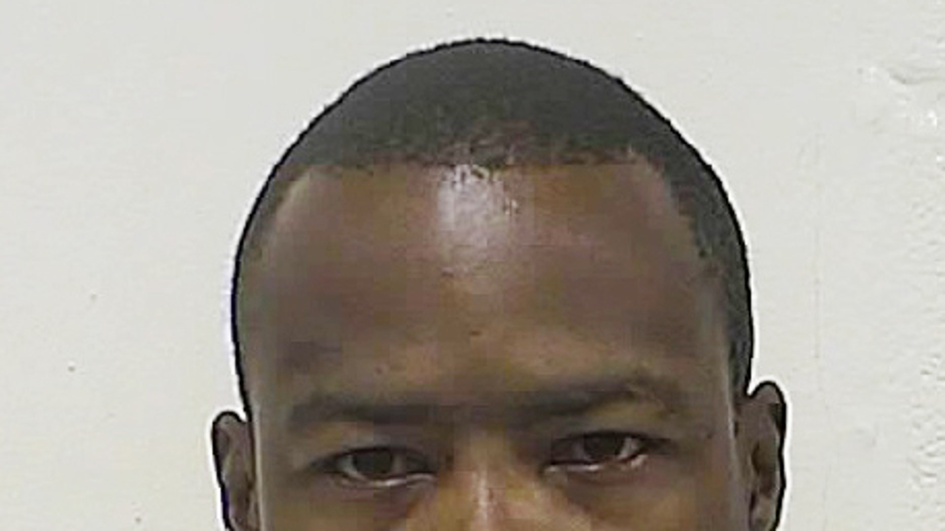 """Darrell Brown is shown in a police booking photo taken July 27, 2013, by the Washington County, Maryland, Sheriff's Office. Brown died April 16, 2015, after Hagerstown, Md., police shocked him with a Taser.  Five Hagerstown police officers involved in the stun-gun-related death of Brown, a home invasion suspect won't be criminally charged, authorities said Thursday, Aug. 6, citing an autopsy report's finding that the man died from drug-induced """"excited delirium in the setting of police restraint.""""(Washington County Sheriff's Office via AP)."""