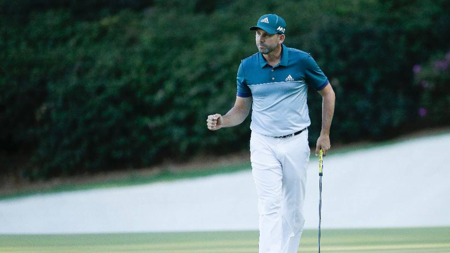 Sergio Garcia, of Spain, reacts after saving par on the 13th hole during the final round of the Masters golf tournament, Sunday, April 9, 2017, in Augusta, Ga. (AP Photo/Charlie Riedel)