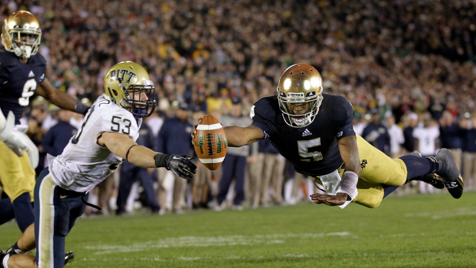 FILE - In this Nov. 3, 2012 file photo, Notre Dame quarterback Everett Golson, right, dives into the end zone in front of Pittsburgh linebacker Joe Trebitz for a two-point conversion to tie the score late in the fourth quarter of an NCAA college football game in South Bend, Ind. Golson is expecting a lot more of himself and the Fighting Irish offense next season.  (AP Photo/Michael Conroy, FILE)