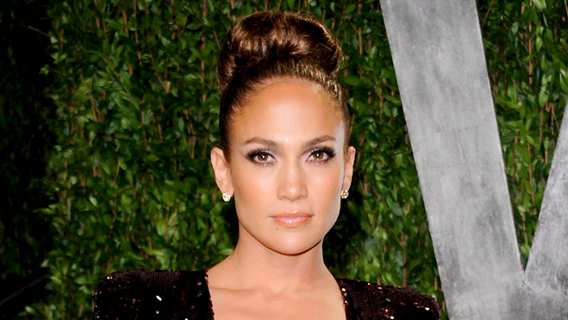 """FILE - In this Feb. 26, 2012 file photo, actress and singer Jennifer Lopez arrives at the Vanity Fair Oscar party in West Hollywood, Calif.  ABC Family announced Thursday, Aug. 23, 2012 that it has greenlighted a pilot titled """"The Fosters,"""" from Jennifer Lopez's production company about a diverse family headed by a lesbian couple. (AP Photo/Evan Agostini, file)"""
