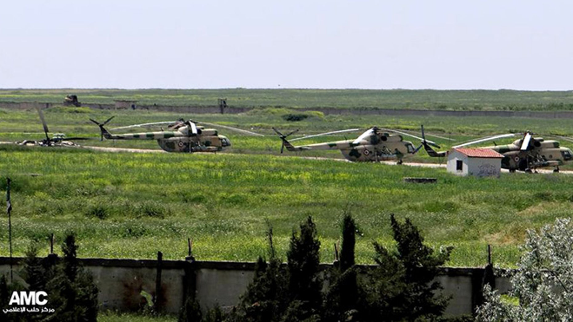 June 18, 2013: In this file photo, citizen journalism image provided by Aleppo Media Center AMC which has been authenticated based on its contents and other AP reporting, shows Syrian military helicopters at Mannagh air base in Aleppo province, Syria.