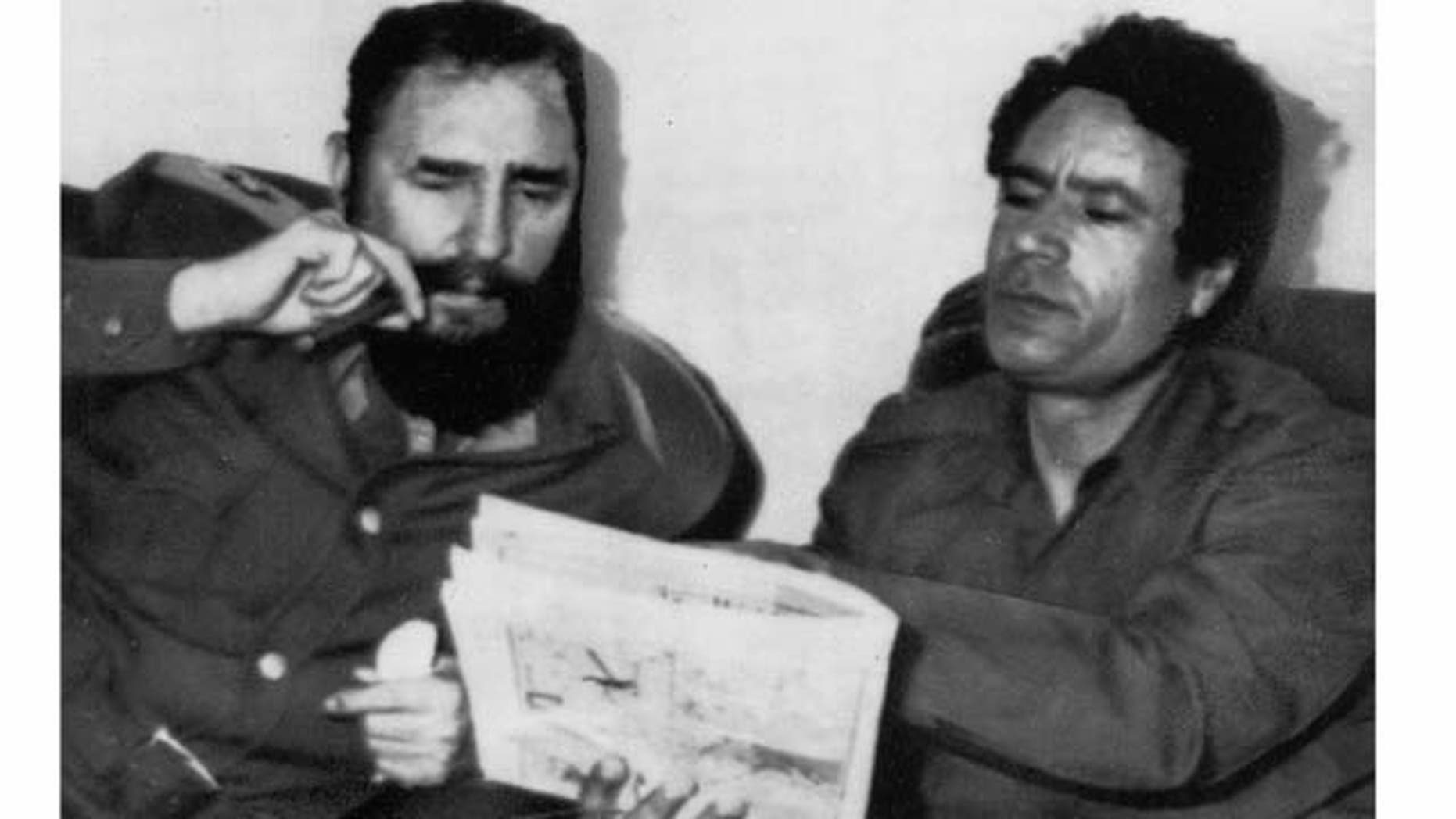 FILE - In this March 8, 1977 file photo Cuban leader Fidel Castro and Moammar Gadhafi meet in Tripoli, Libya. As rebels swarmed into Tripoli late Sunday, Aug. 21, 2011, and Gadhafi's son and one-time heir apparent Seif al-Islam was arrested, Gadhafi's rule was all but over, even though some loyalists continued to resist. (AP Photo, File)