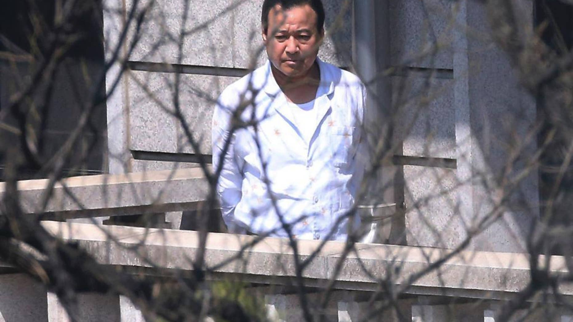 South Korean Prime Minister Lee Wan Koo walks on the terrace of his residence in Seoul, South Korea, Tuesday, April 21, 2015. Lee has offered to resign amid a bribery scandal just two months after he took up the country's No. 2 post, officials said Tuesday, in the latest political crisis to hit President Park Geun-hye. (Kim Bong-kyu/The Hankyoreh via AP) KOREA OUT