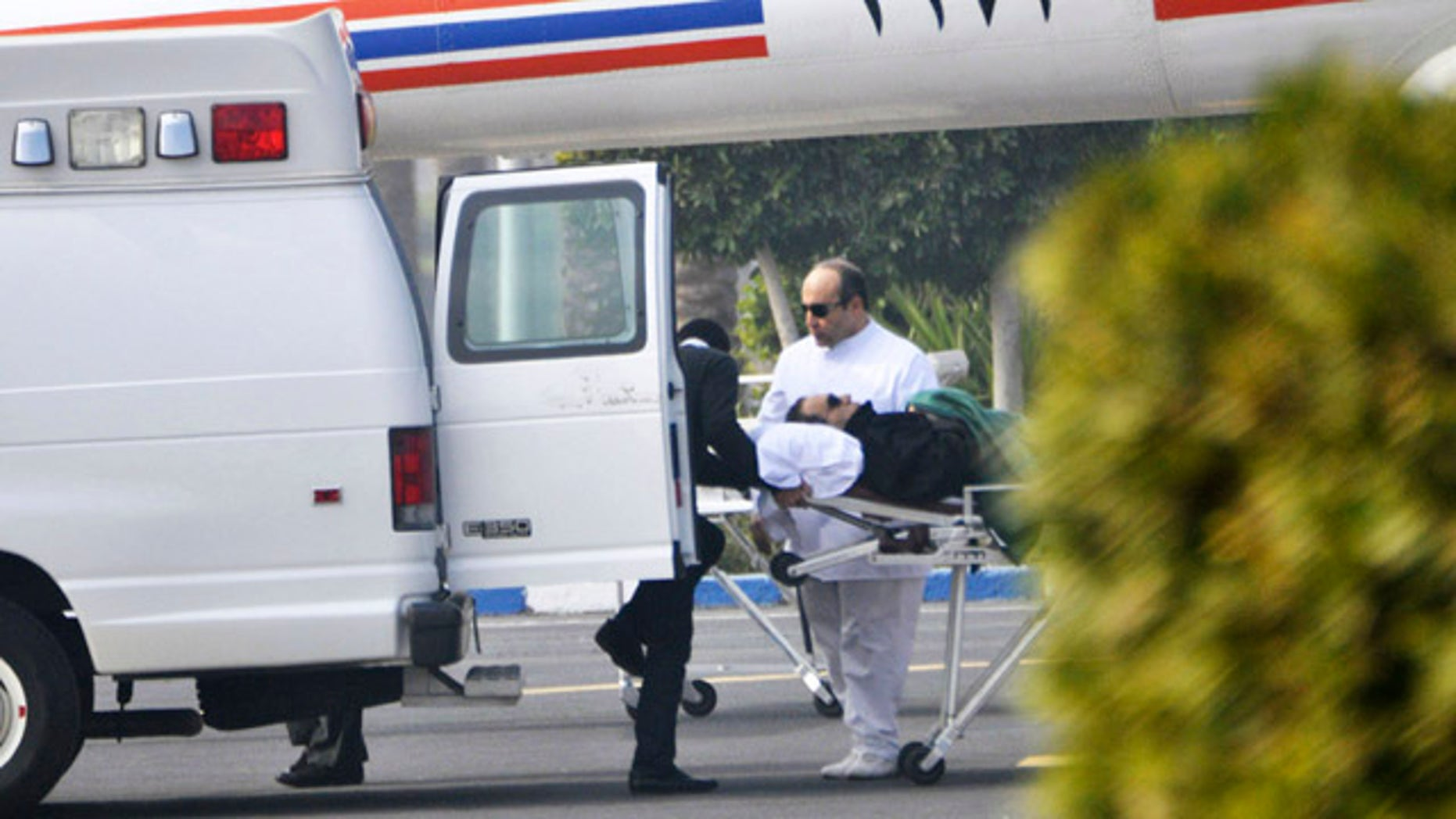 Jan. 4, 2012: Former Egyptian president Hosni Mubarak is wheeled into a van after attending a trial in Cairo, Egypt.