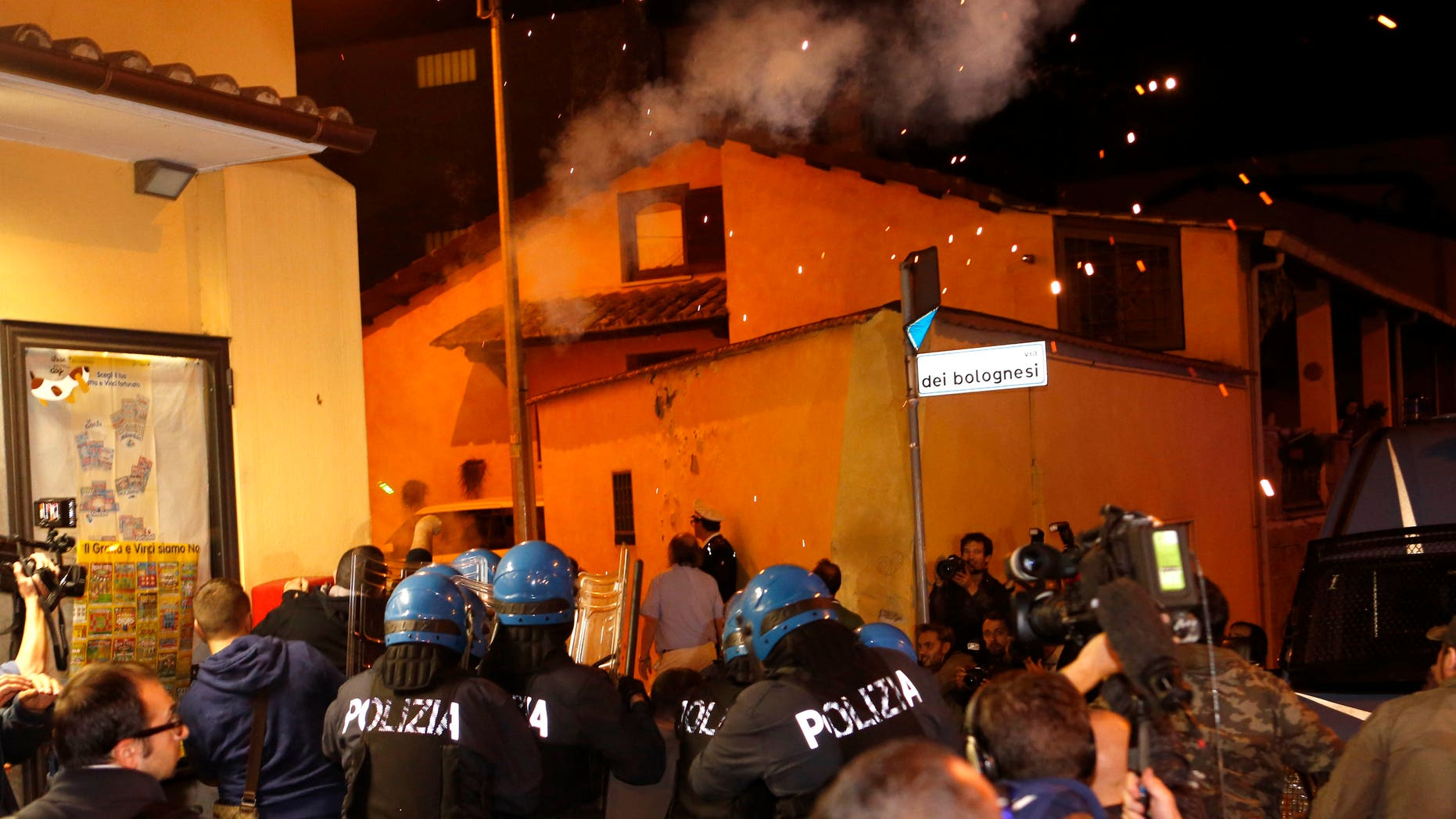 Oct. 15, 2013: Police in riot gear go after protesters after scuffles broke out outside the Society of St. Pius X, a schismatic Catholic group, where funeral of Nazi war criminal Erich Priebke was scheduled to take place, in Albano Laziale, on the outskirts of Rome.