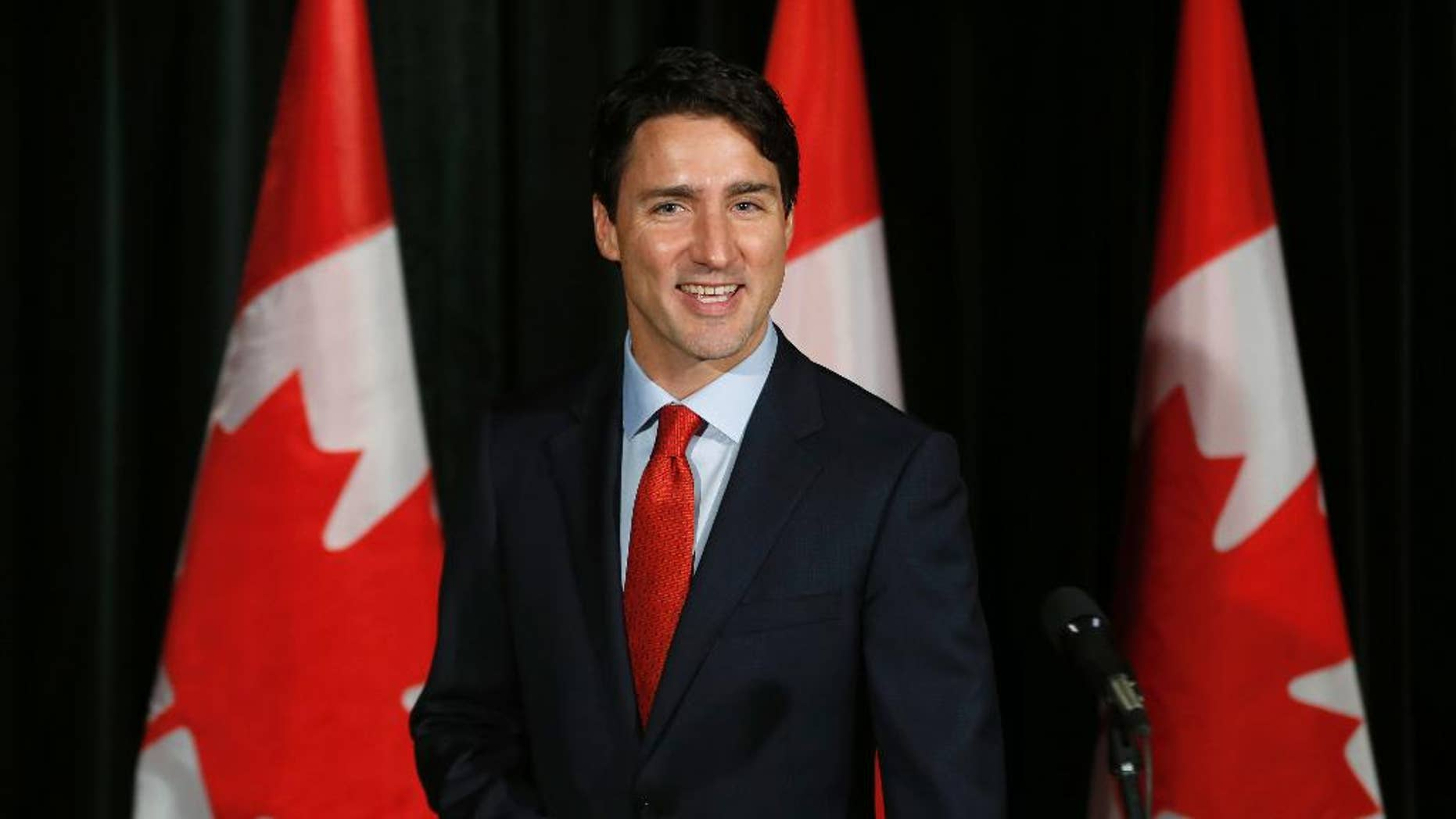 Canadian Prime Minister Justin Trudeau greets the press before going into the Liberal cabinet retreat in Calgary, Alberta, Monday, Jan. 23, 2017. (Todd Korol/The Canadian Press via AP)