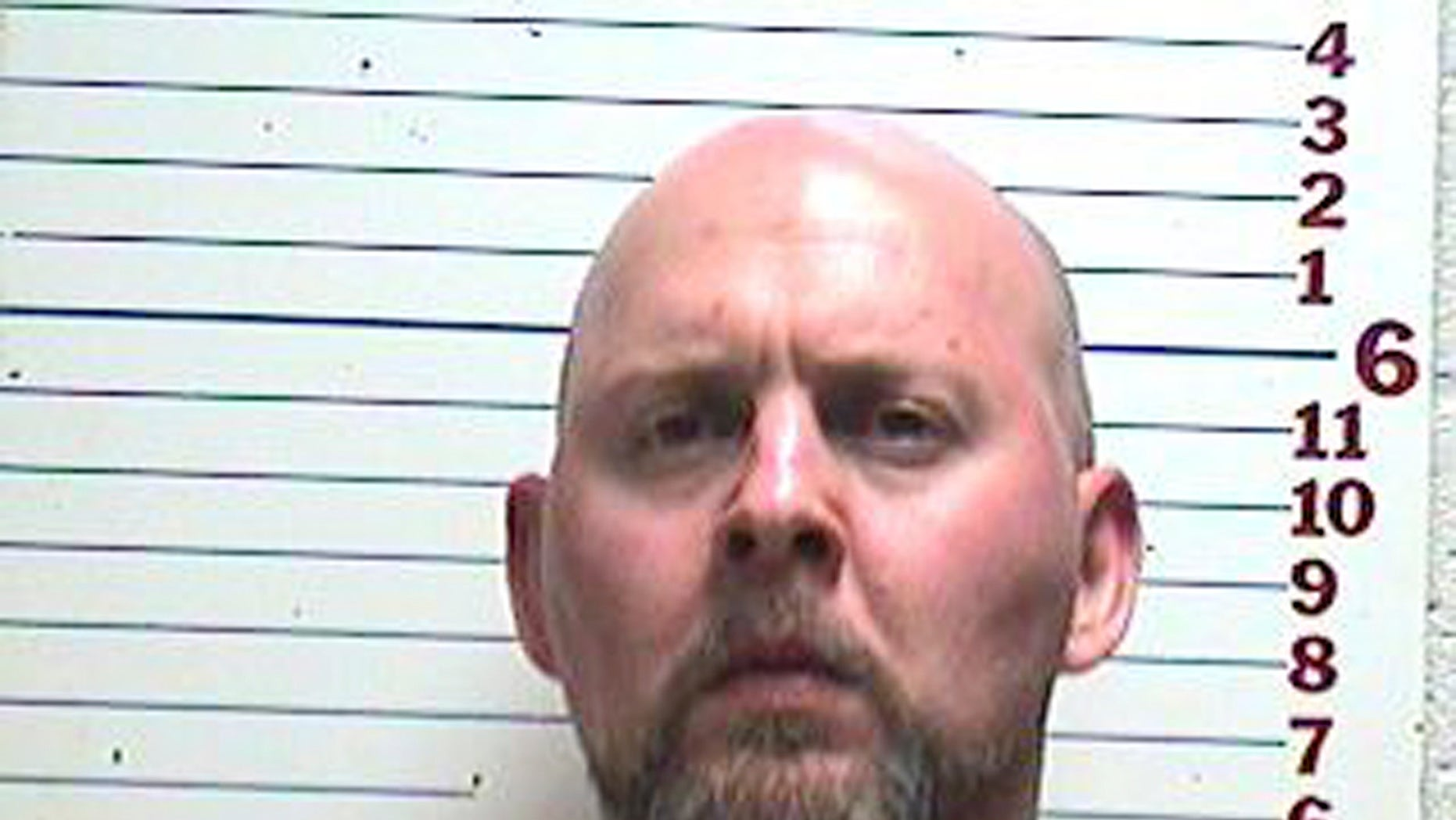 In this photo provided by the Comanche County Detention Center, David Lee Kemp is pictured in a booking photo dated April 26, 2013. Authorities in southwest Oklahoma say they've captured Kemp, a murder suspect who's been on the run since a brazen jail escape with eight other inmates in 1999. Kemp was the only inmate to elude capture after escaping the Comanche County jail on March 11, 1999. He was awaiting trial on two first-degree murder counts in the killings of his ex-wife and another man. (AP Photo/Comanche County Detention Center)