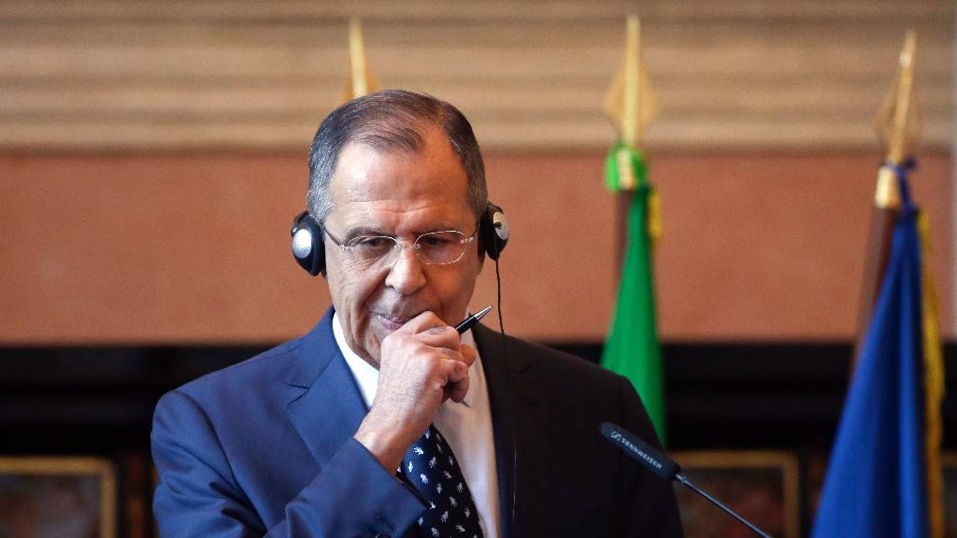 Russian Foreign Minister Sergey Lavrov meets the media during a news conference at the Mediterranean Dialogues Conference Forum, in Rome, Friday, Dec. 11, 2015. (AP Photo/Alessandra Tarantino)