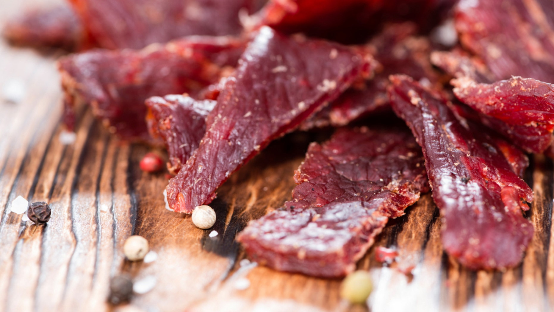 Portion of Beef Jerky on vintage wooden background