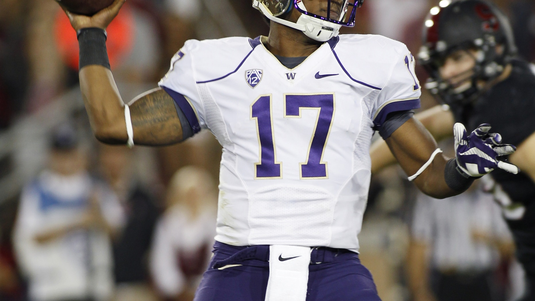 Washington quarterback Keith Price throws a pass against Stanford during the first half of an NCAA college football game in Stanford, Calif., Saturday, Oct. 5, 2013. (AP Photo/George Nikitin)