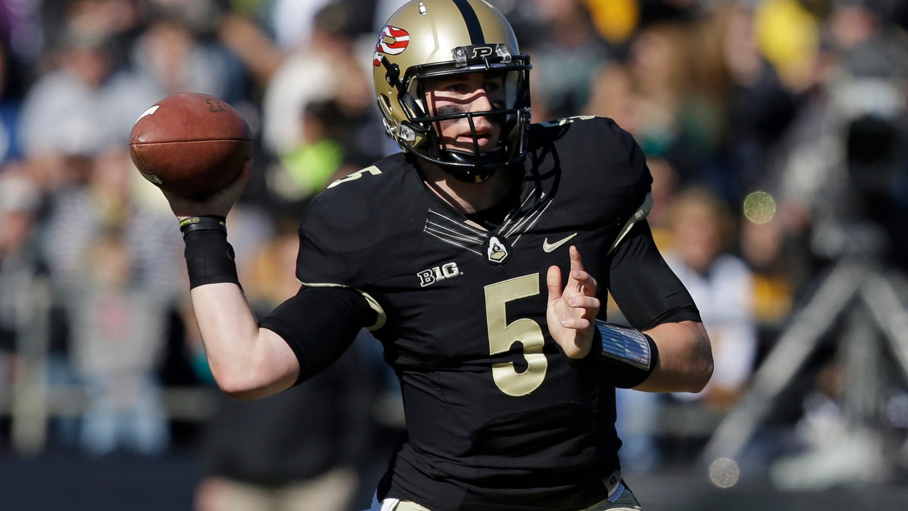 Purdue quarterback Danny Etling throws against Iowa during the first half of an NCAA college football game in West Lafayette, Ind., Saturday, Nov. 9, 2013. (AP Photo/Michael Conroy)
