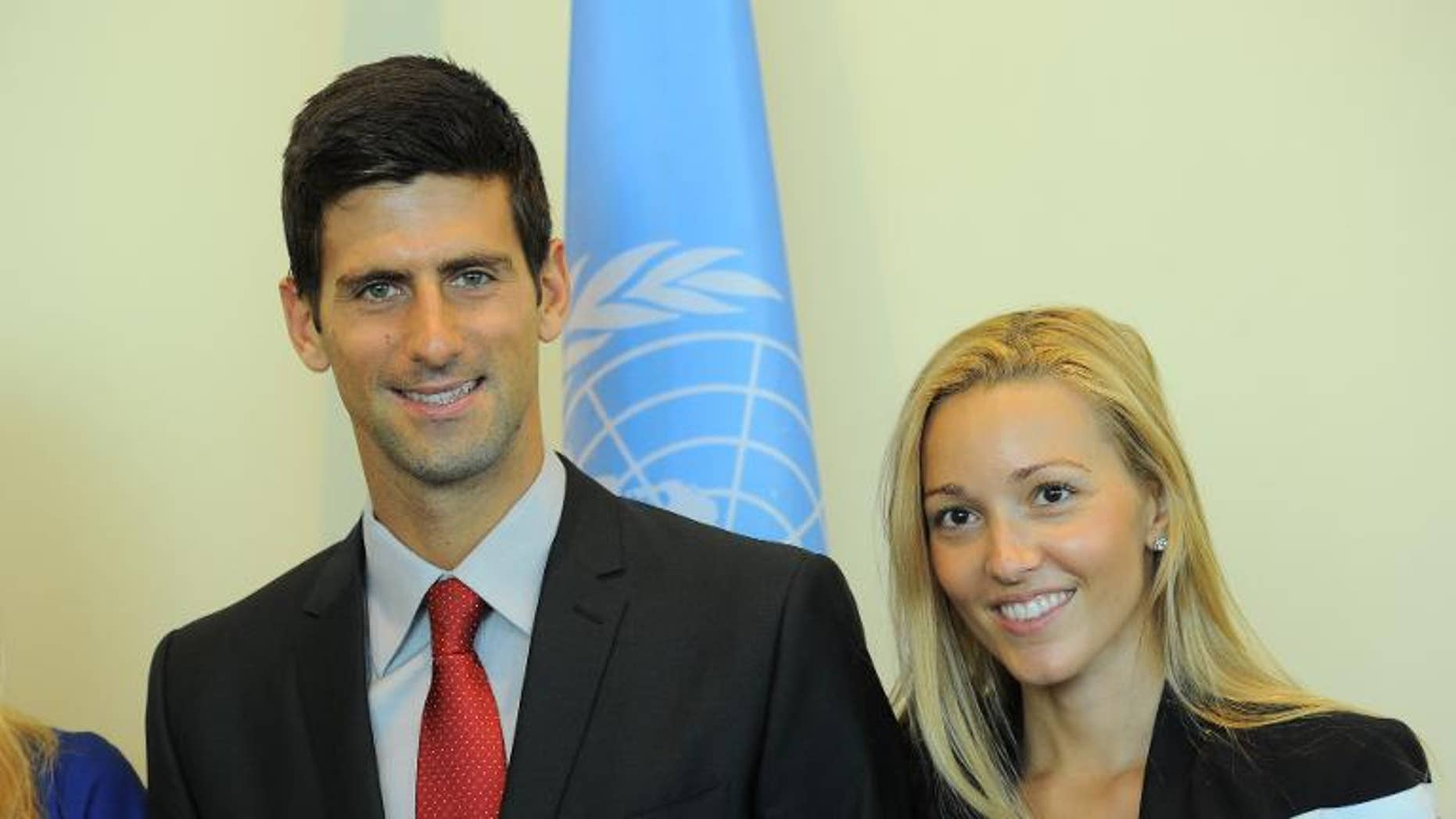 Serbian tennis player Novak Djokovic (L) and his girlfriend Jelena Ristic pose for a photo at the United Nations headquarters in New York, on August 23, 2013.