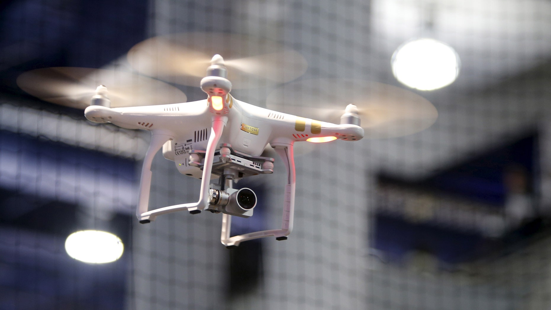 A DJI Phantom 3 Professional drone with 4K video flies in a drone cage during the 2016 CES trade show in Las Vegas, Nevada January 8, 2016 (REUTERS/Steve Marcus).