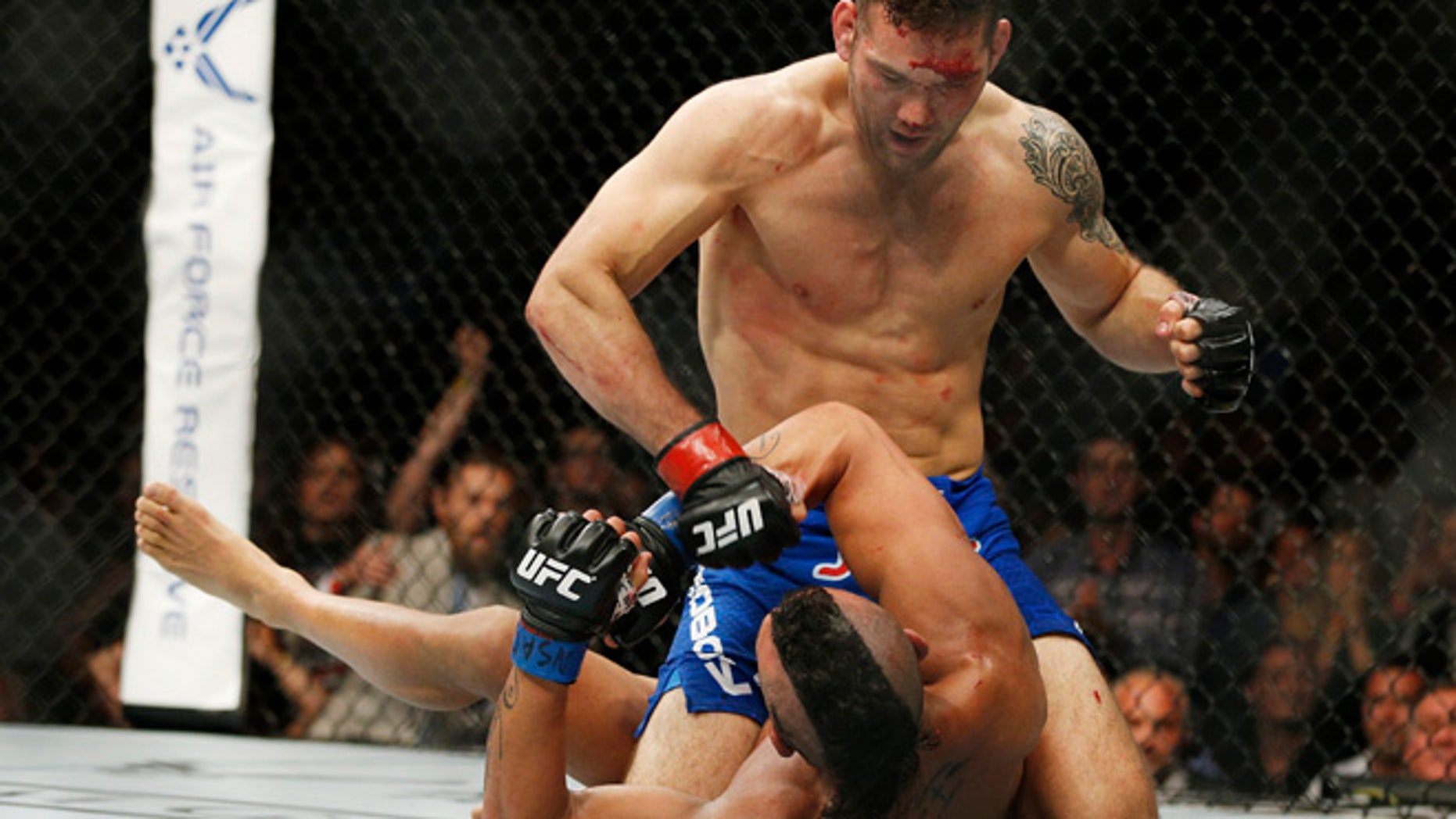 Chris Weidman pounds Vitor Belfort during their middleweight mixed martial arts bout at UFC 187 Saturday, May 23, 2015, in Las Vegas. (AP Photo/John Locher)