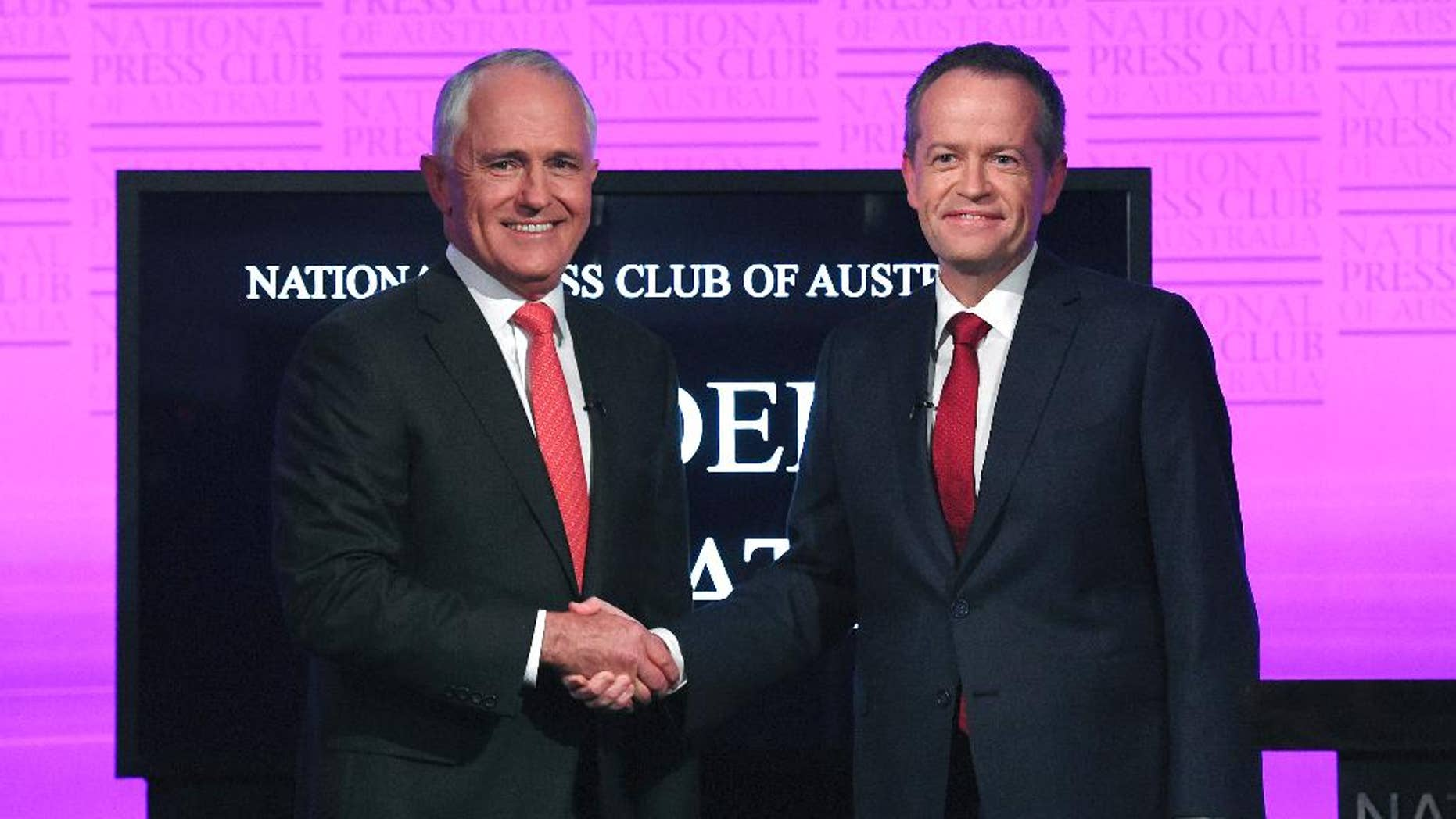 FILE - In this May, 29, 2016 file photo, Australian Prime Minister Malcolm Turnbull, left, and opposition leader Bill Shorten shake hands as they arrive for the leaders' debate at the National Press Club in Canberra. Turnbull said Tuesday, June 7 that he had reached an agreement with Facebook and News Corp. Australia to stream the debate early next week in a bid to reach more voters. Shorten later agreed to participate. (Tracey Nearmy/Pool Photo via AP, File)