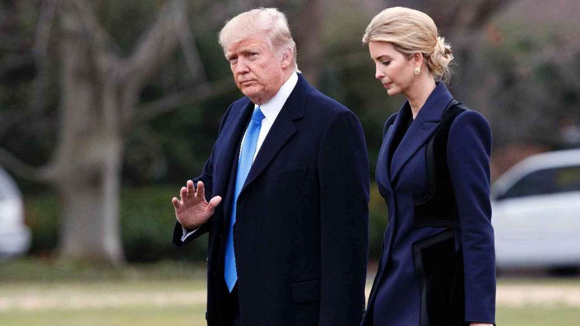 In this Feb. 1, 2017, photo, President Donald Trump, accompanied by his daughter Ivanka, waves as they walk to board Marine One on the South Lawn of the White House in Washington. She may have no official White House title. But Ivanka Trump is already proving that she is an unofficial power player. The first daughter has made clear that she wants to work on policy and support her father. (AP Photo/Evan Vucci)