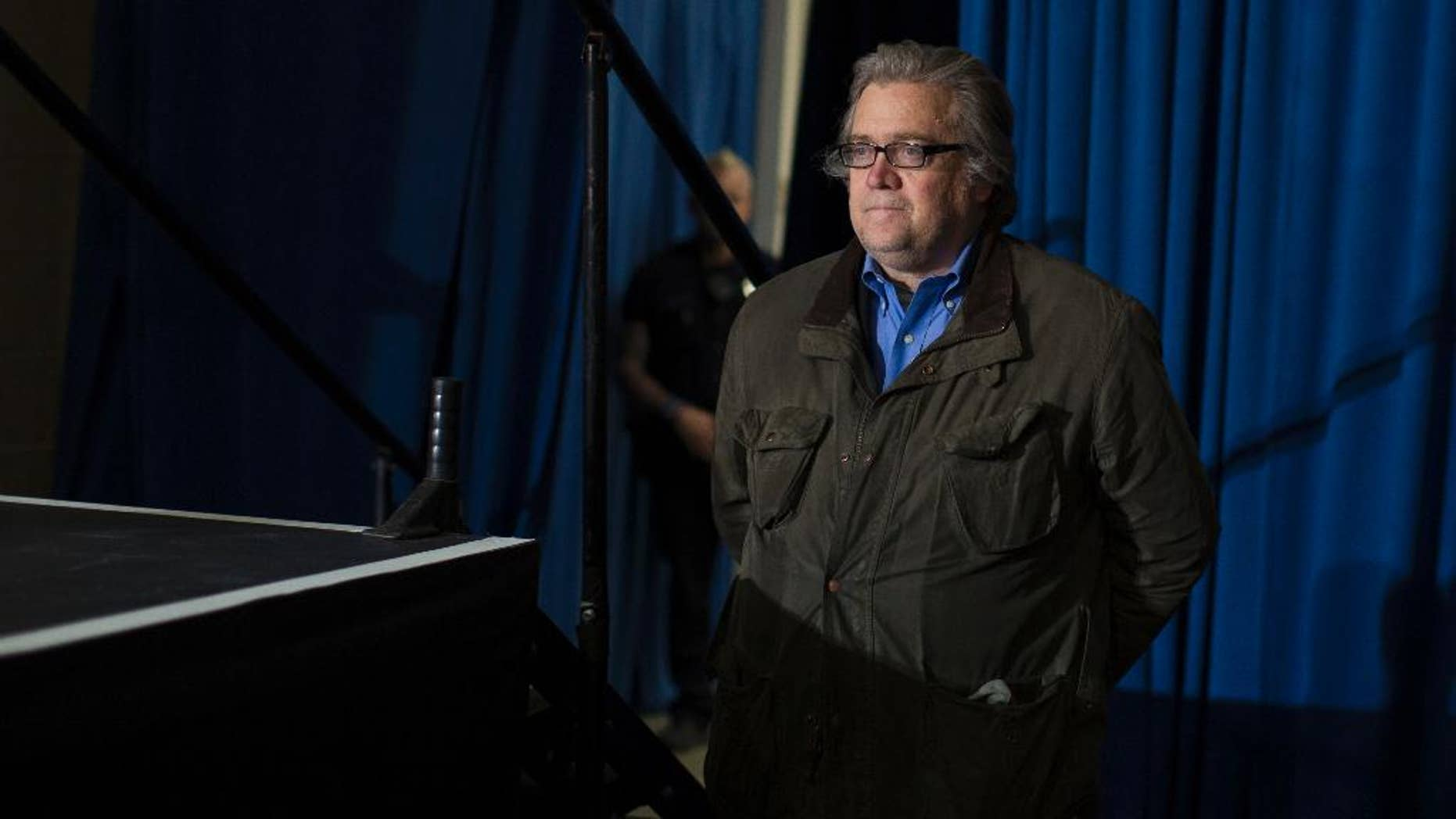 FILE - In this Saturday, Nov. 5, 2016, file photo, Stephen Bannon, campaign CEO for Republican presidential candidate Donald Trump, looks on as Trump speaks during a campaign rally in Denver. Following the installation of Breitbart's chief executive, Bannon, to a top job in President-elect Trump's administration, the news organization in its infancy when Barack Obama took office has big expansion plans and the goal of being the best source of news on the new administration. (AP Photo/Evan Vucci, File)
