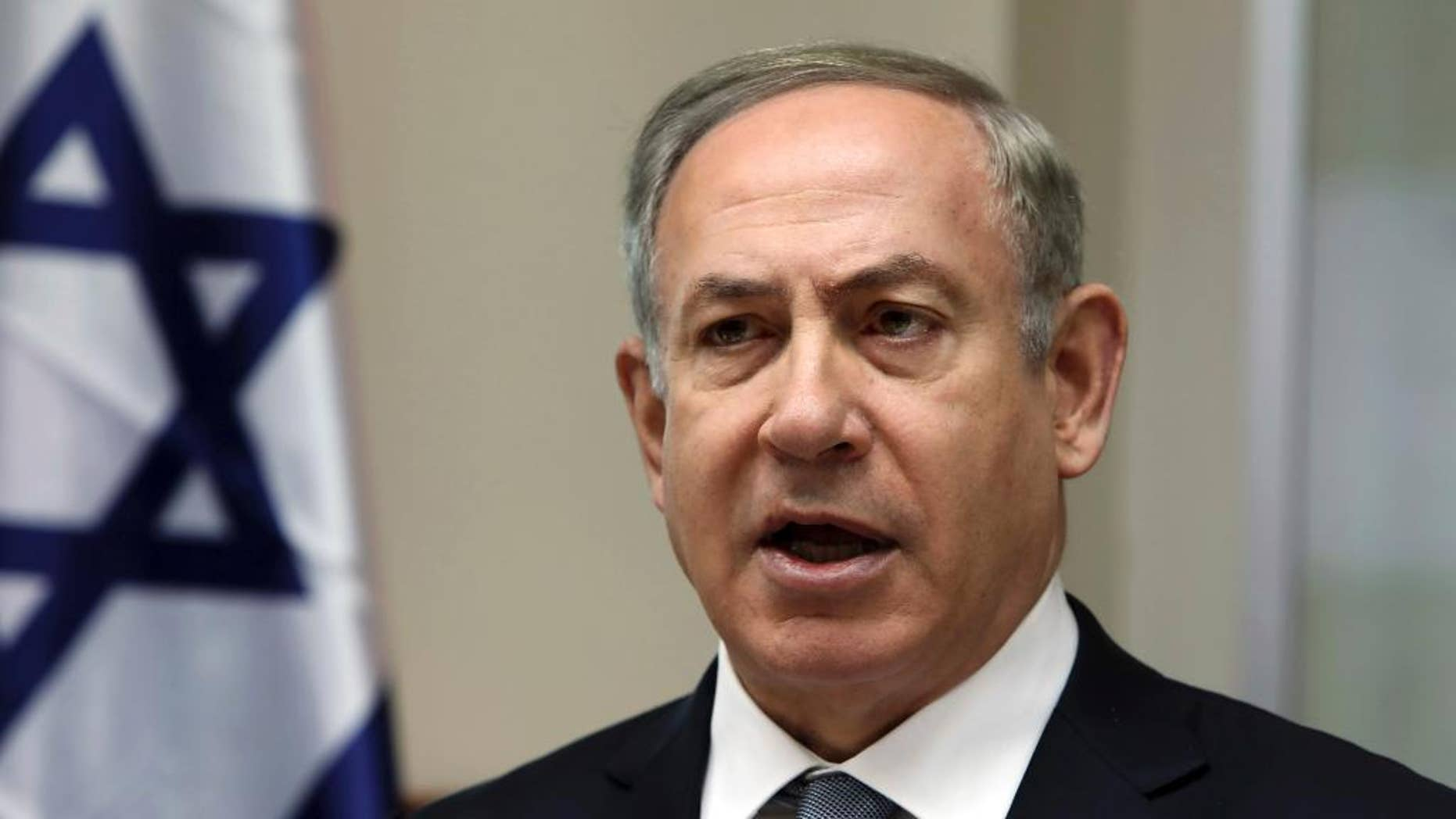FILE - In this Sunday, Feb. 12, 2017 file photo, Israeli Prime Minister Benjamin Netanyahu chairs the weekly cabinet meeting in Jerusalem. As Netanyahu visits the White House, the Trump administration has suggested that peace between the Israelis and Palestinians may not come in the form of a two-state solution — a position that could represent a dramatic shift from 20 years of U.S. policy. Speaking to reporters ahead of President Donald Trump's meeting Wednesday with Netanyahu, a senior White House official said Tuesday, Feb. 14, 2017, that Trump is eager to begin facilitating a peace deal between the two sides and hoping to bring them together soon. (Gali Tibbon, Pool via AP, File)