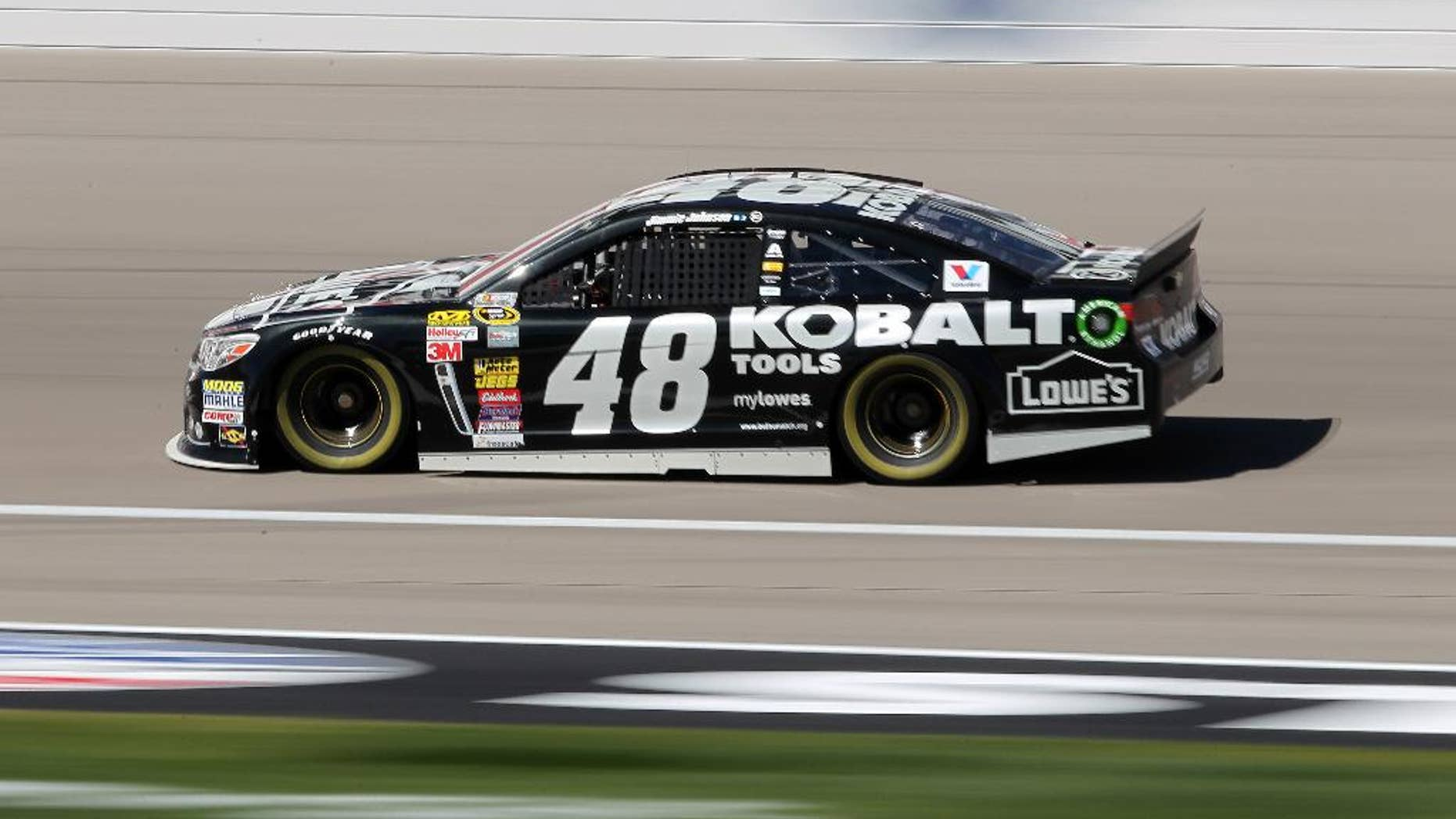 Jimmie Johnson drives during NASCAR Sprint Cup auto racing practice Friday, March 7, 2014, in Las Vegas. (AP Photo/Isaac Brekken)