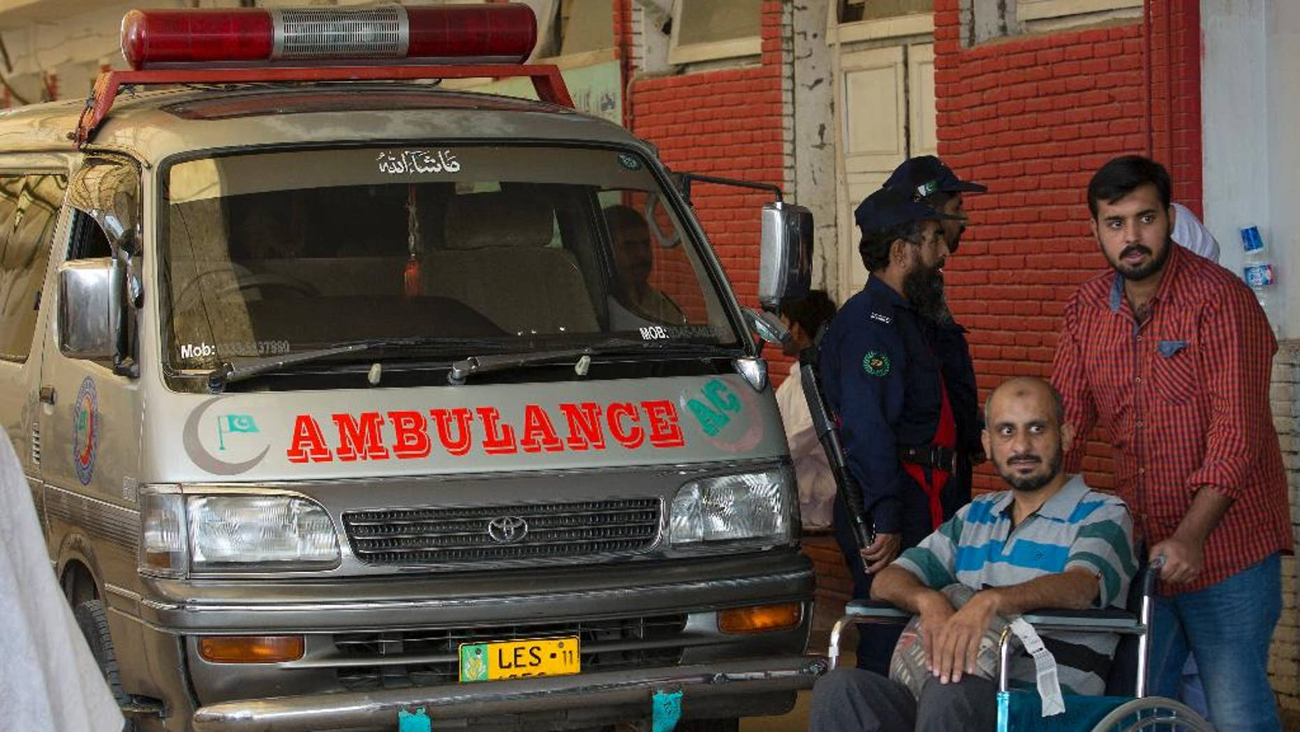 An ambulance that brought the body of a Spanish diplomat is parked at a clinic in Islamabad, Pakistan, Thursday, Oct. 13, 2016. Pakistani police say a Spanish diplomat has been found dead in his Islamabad home in what authorities suspect is a suicide. Police officer Iftikhar Chatha said Thursday that the 60-year-old man was found in his bedroom by a domestic servant. (AP Photo/B.K. Bangash)