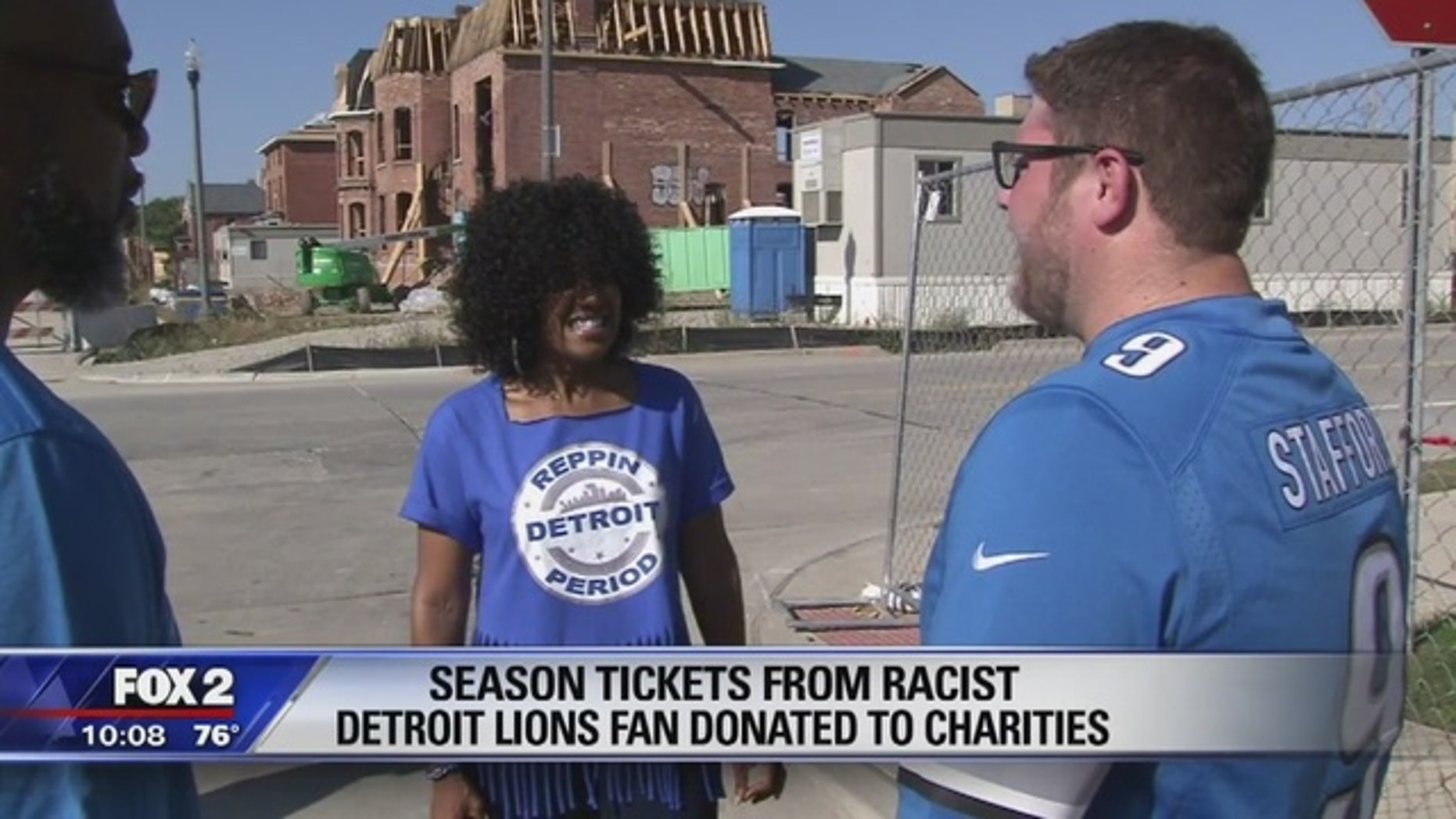 Lions fan and season ticketholder Stacey Graham (center) was happy to find out the Detroit Lions season tickets of a businessman who shamed her with a racial slur online would be given to charity.