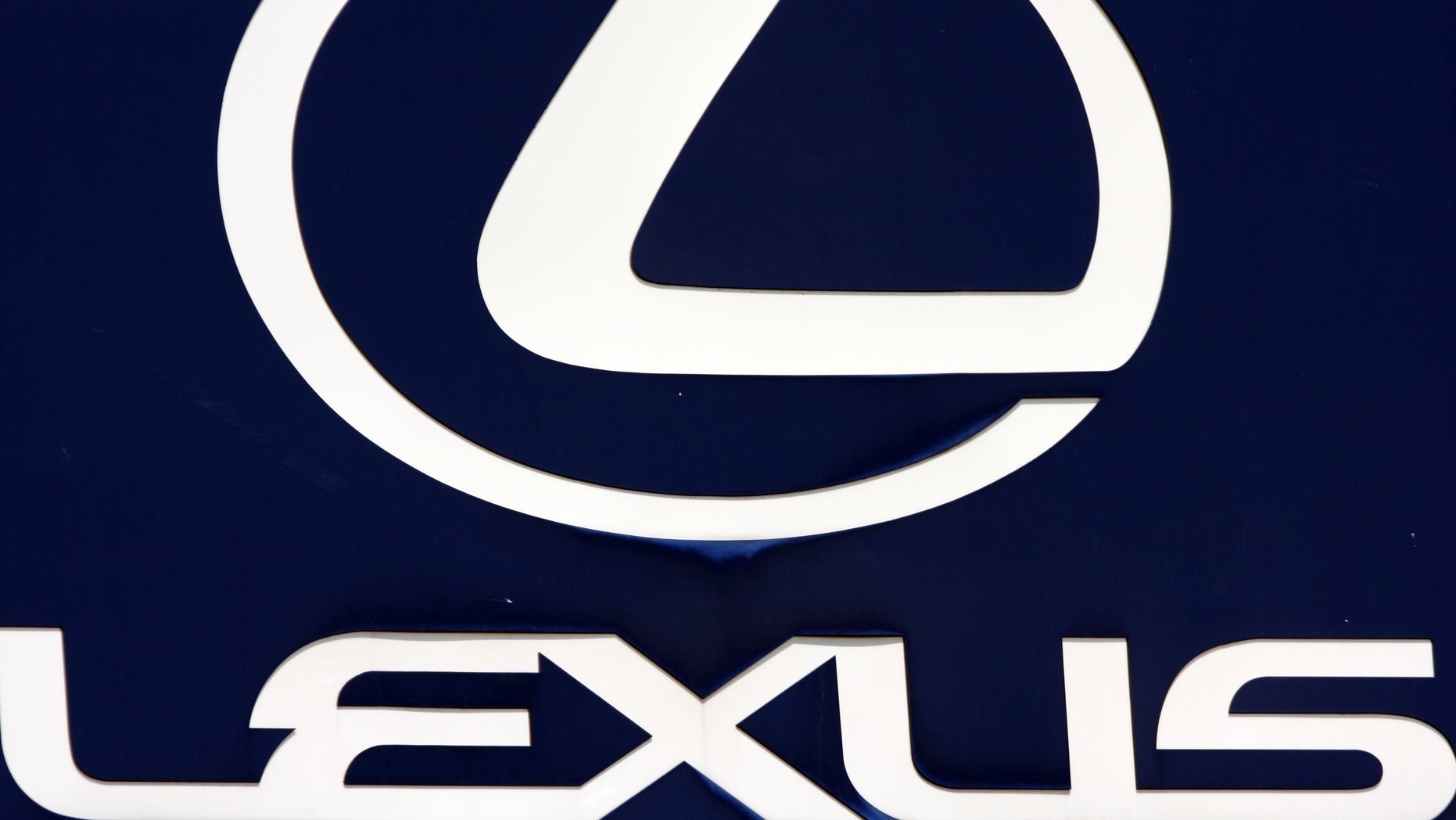 FILE - In this April 13, 2010 file photo, the Lexus logo is seen on a sign at a dealership in Portland, Maine. Toyota is recalling 907,000 vehicles, mostly Corolla models, around the world for faulty air bags and another 385,000 Lexus IS luxury cars for defective wipers. Toyota Motor Corp. spokesman Naoto Fuse said Wednesday, Jan. 30, 2013, there have been no accidents or injuries related to either of those defects, but the Japanese automaker received 46 reports of problems involving the air bags from North America, and one from Japan. There were 25 reports of problems related to the windshield wipers. (AP Photo/Pat Wellenbach, File)