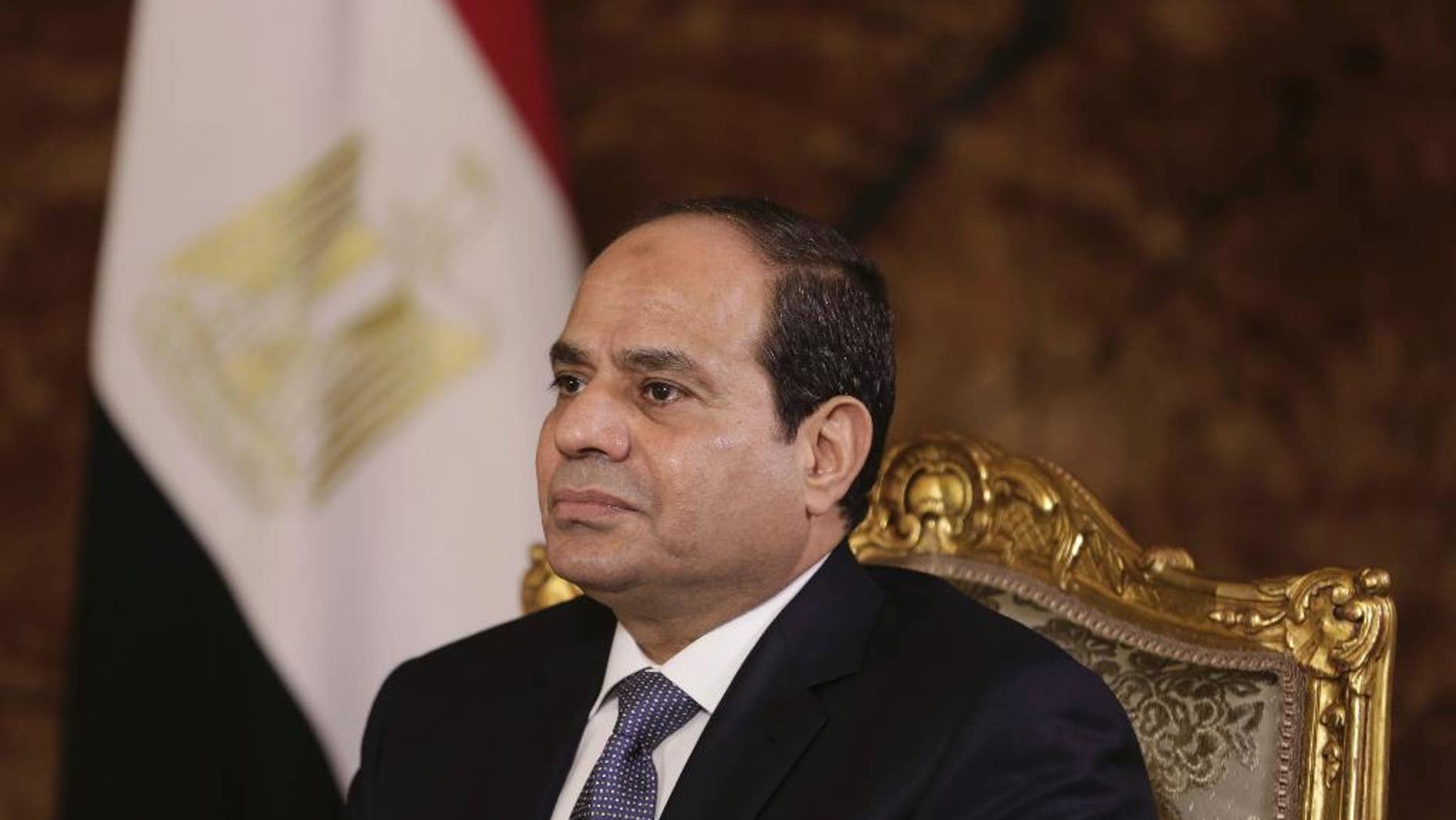 FILE - In this Sept. 20, 2014 file photo, Egyptian President Abdel-Fattah el-Sissi listens during an interview with The Associated Press at the presidential palace in Cairo. Egypt's President Abdel-Fattah el-Sissi is praising U.S. President-elect Donald J. Trump saying Trump's words as a presidential candidate will be different from his actions as a president. (AP Photo/Maya Alleruzzo, File)