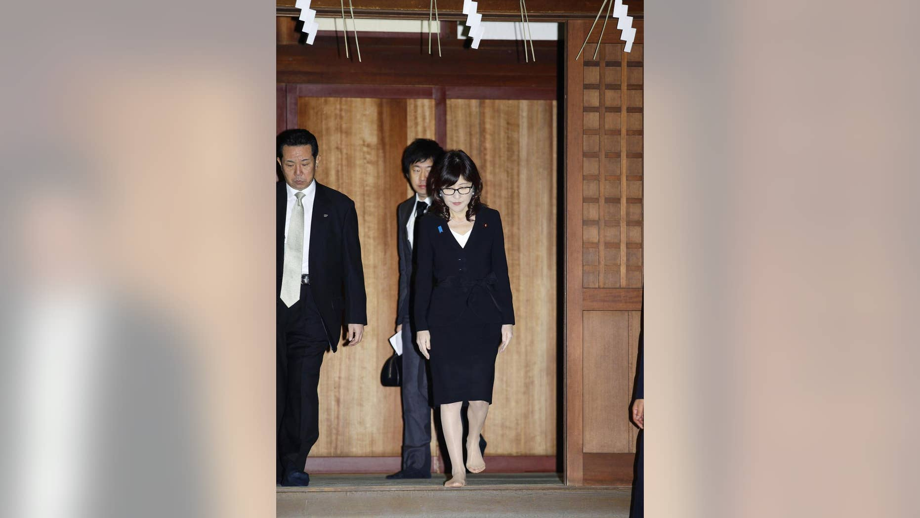 Japan's Defense Minister Tomomi Inada, front right, visiting the controversial shrine.