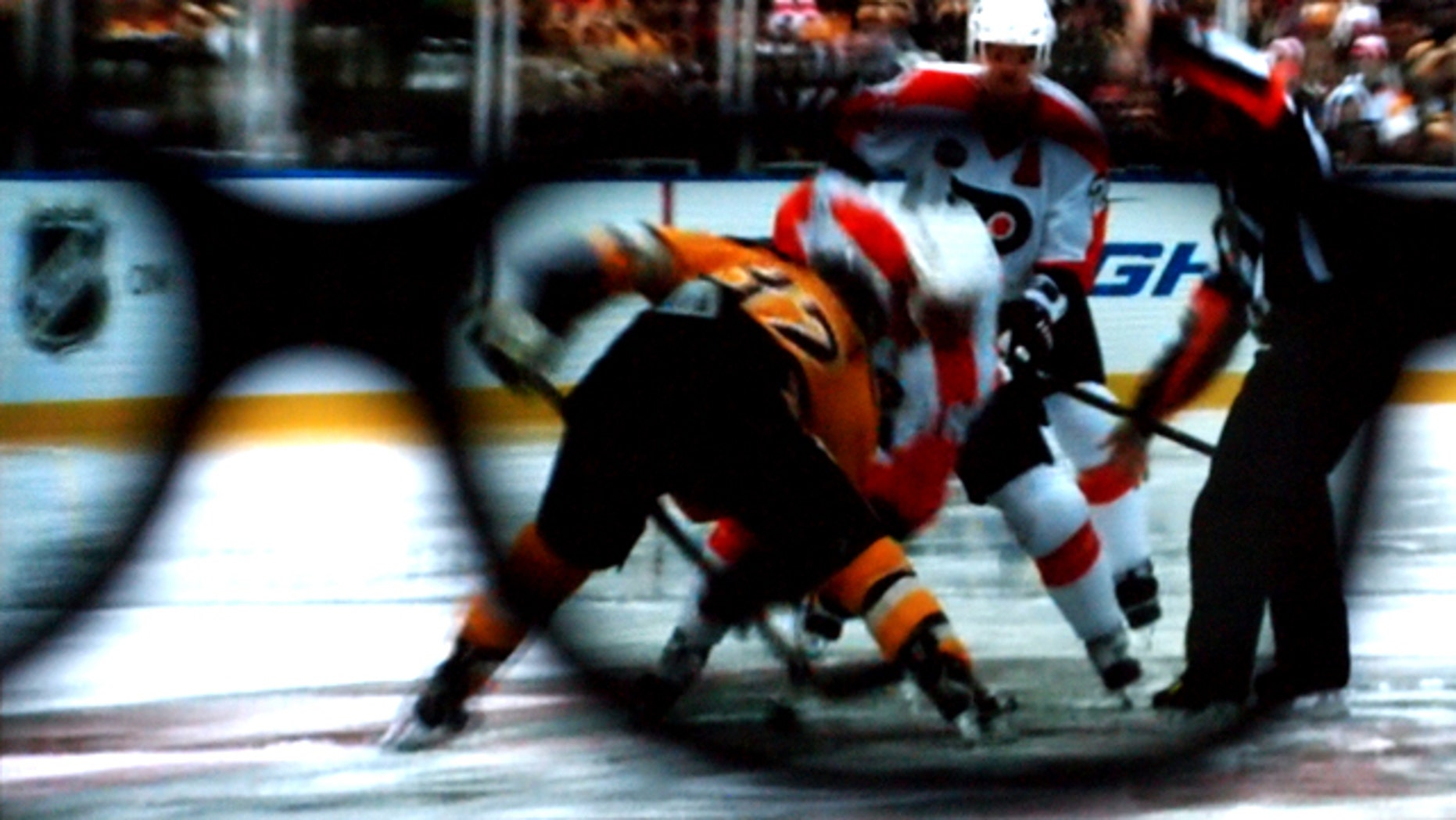 """The view through the 3D lens as the """"Winter Classic"""" -- a hockey match from earlier in the year -- is rebroadcast during intermission at Madison Square Garden Wednesday, March 24, 2010."""