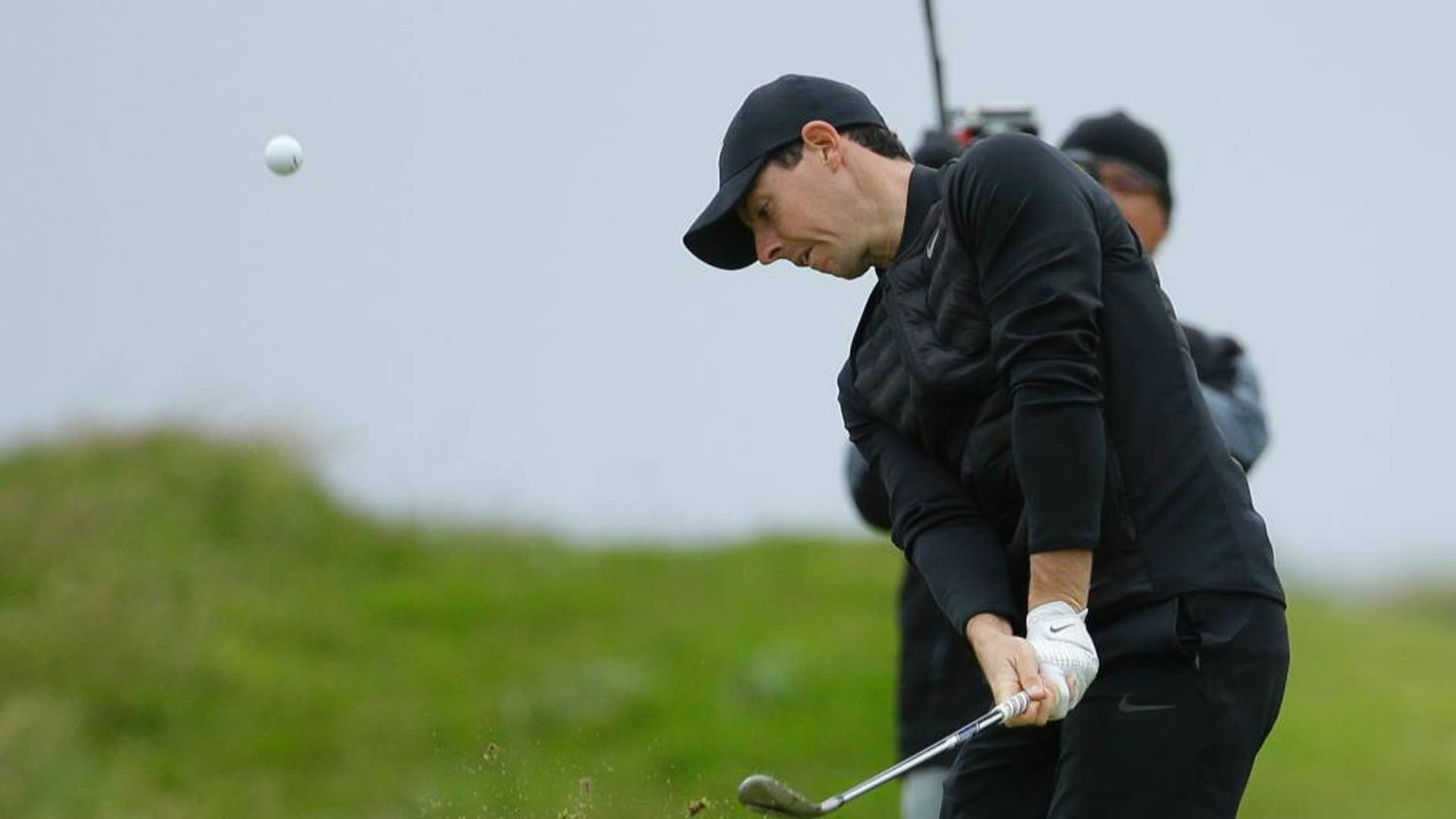 Rory McIlroy of Northern Ireland hits a shot from the 3rd fairway during the third round of the British Open Golf Championship at the Royal Troon Golf Club in Troon, Scotland, Saturday, July 16, 2016. (AP Photo/Matt Dunham)