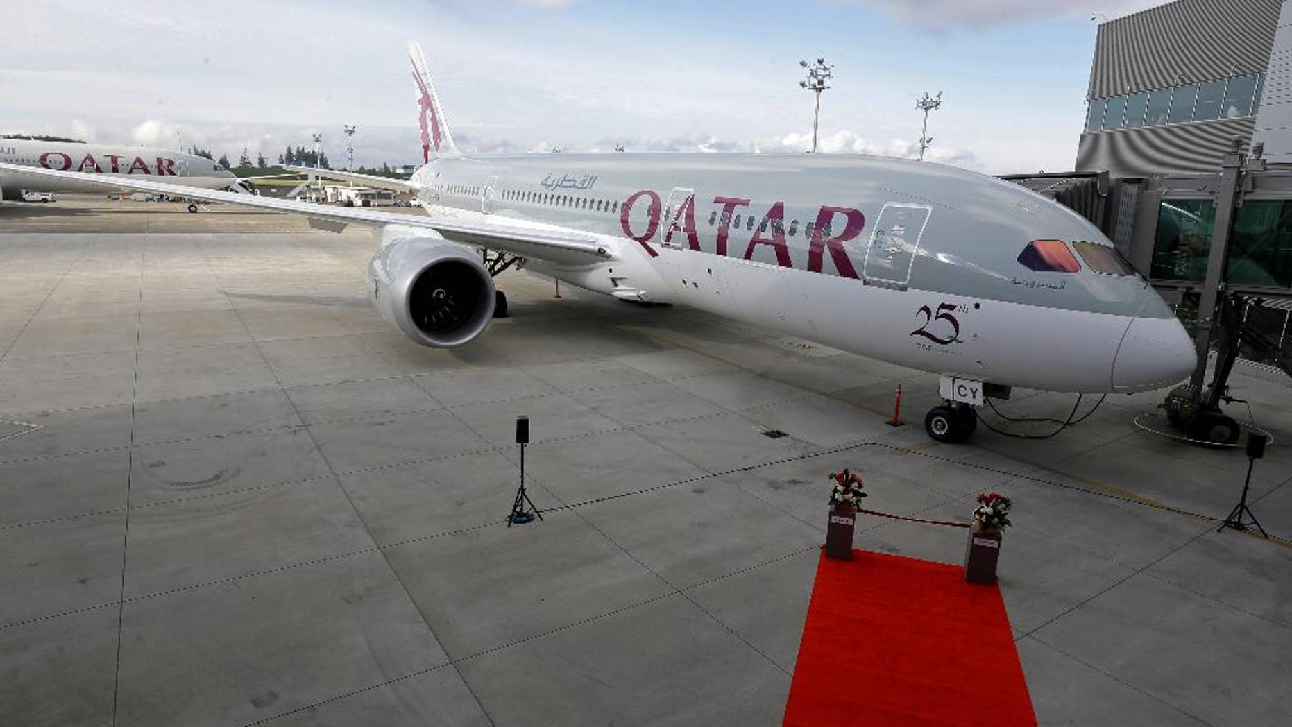 FILE -- In this Nov. 4, 2015  file photo, a Boeing 787 airplane purchased by Qatar Airways is shown during a delivery ceremony in Everett, Wash. Qatar Airways, one of the Middle East's biggest carriers, announced Sunday, July 10, 2016, net profits of $445 million in 2016, up from $103 million the previous year. It says the airline's revenue rose from $9.3 billion in 2015 to $9.6 billion. Qatar Airways Group Chief Executive Akbar Al-Baker said it was the 19-year-old airline's best fiscal year to date. (AP Photo/Ted S. Warren, File)