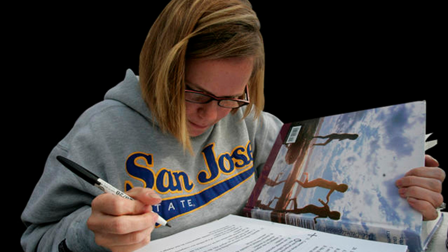 Robin Hendrickson studies for a child development class on the campus of San Jose State  University in San Jose, Calif., Wednesday, Nov. 19, 2008. The California State University system, faced with a budget crisis, is proposing a plan to slash enrollment by 10,000 students from the upcoming academic year. (AP Photo/Marcio Jose Sanchez)