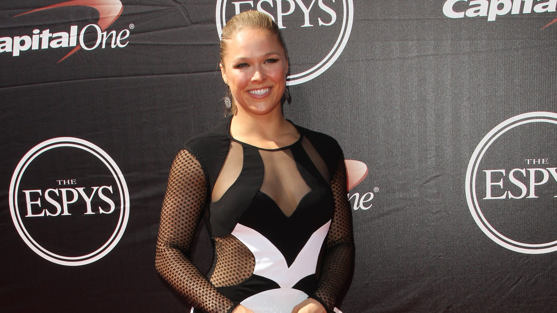 Ronda Rousey, UFC women's bantamweight champion, arrives at the ESPY Awards on Wednesday, July 15, 2015, in Los Angeles. (Photo by Paul A. Hebert/Invision/AP)