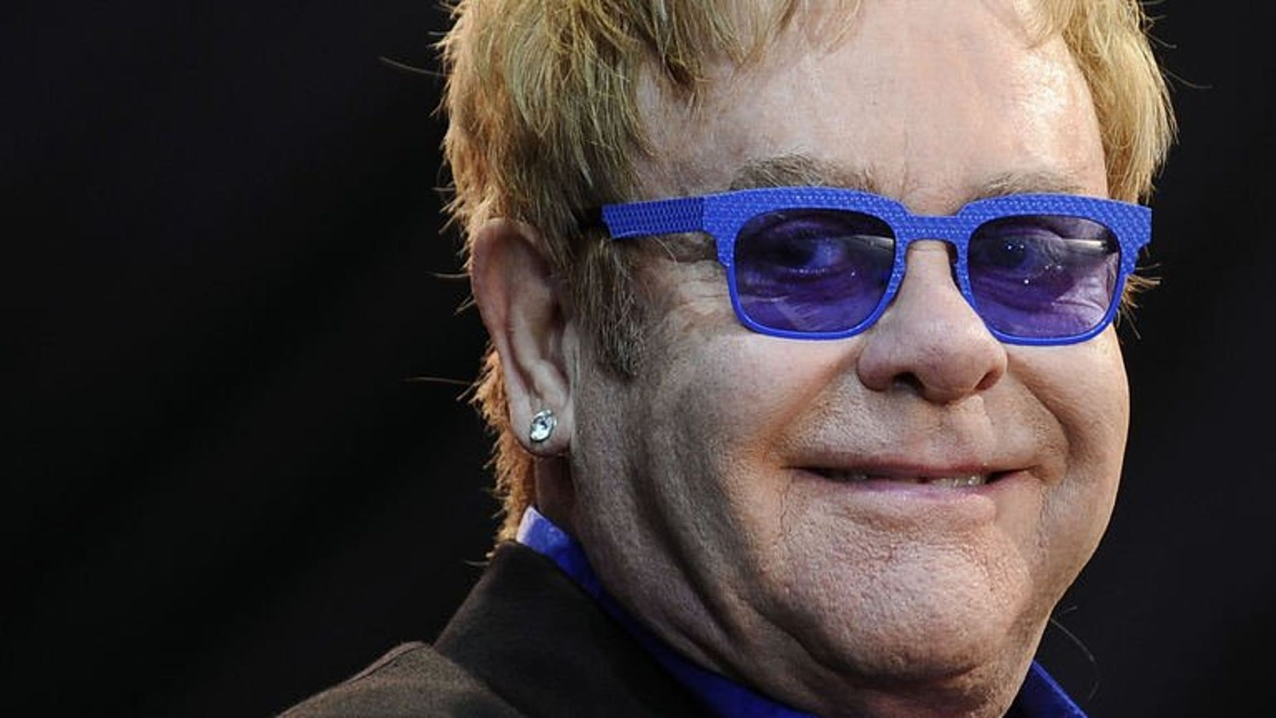 Elton John performs on stage during the Poupet festival on July 3, 2013 in Saint-Laurent-sur-Sevre, western France. John has cancelled the rest of his European tour after he was struck down with appendicitis, his spokesman said on Tuesday.