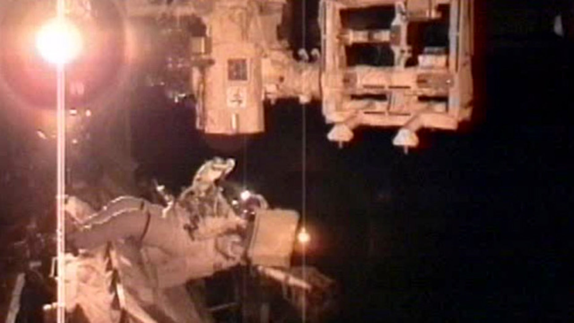 In this image taken from NASA television astronaut Andrew Feustel, prepares his tools that he will use to lubricate DEXTER platform's robotic arm during the second space walk early Sunday May 22, 2011.