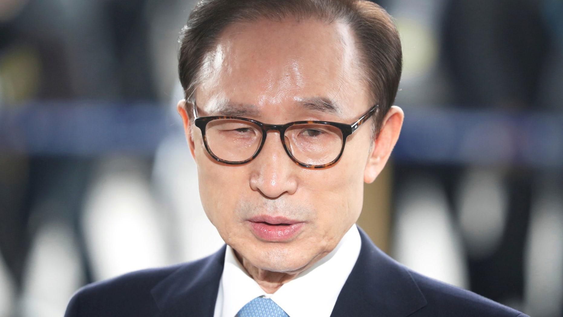FILE: South Korea's former president Lee Myung-bak arrives at the prosecutors' office in Seoul.