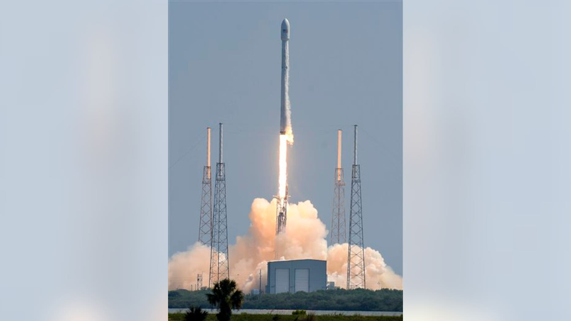 A SpaceX Falcon 9 rocket blasts off from Cape Canaveral Air Force Station Wednesday morning, June 15, 2016, carrying a pair of commercial communications satellites. (Craig Bailey/Florida Today via AP)