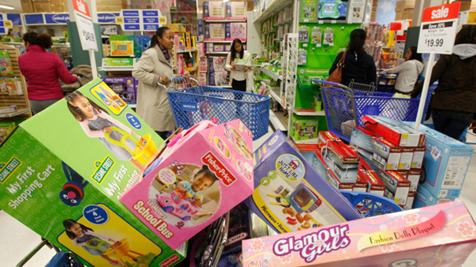 November 27, 2009: Shoppers look through the aisles during a Black Friday sales event at a Toys R Us store in Falls Church, Virginia.