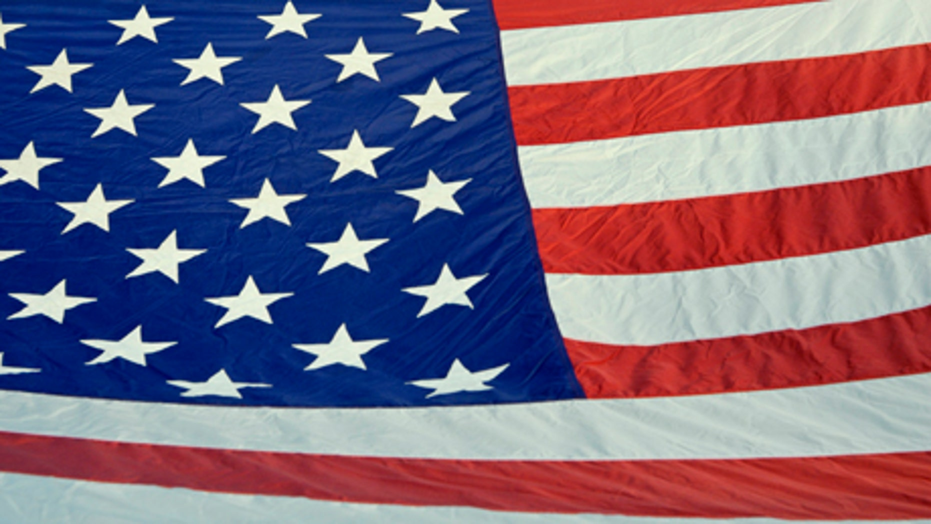 A Texas man claims he was forced to remove an American flag like this one from his balcony.