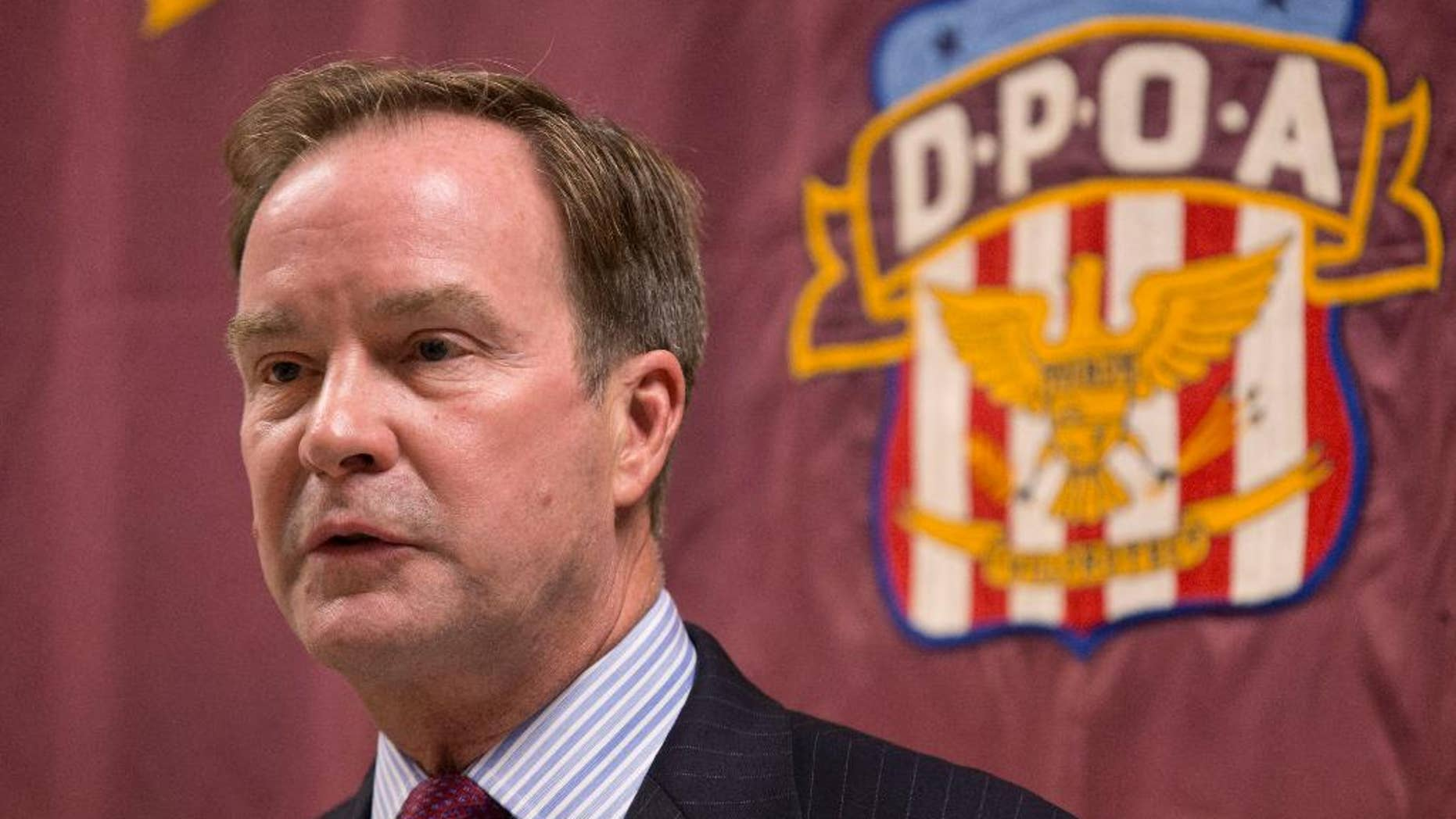 FILE - In this Sept. 10, 2014 file photo, Attorney General Bill Schuette speaks at the Detroit Police Officers Association in Detroit. Michigan's attorney general Schuette will announce criminal charges Wednesday, April 20, 2016, against two state regulators and a Flint employee, alleging wrongdoing related to the city's lead-tainted water crisis, according to government officials familiar with the investigation. (AP Photo/Paul Sancya, File)