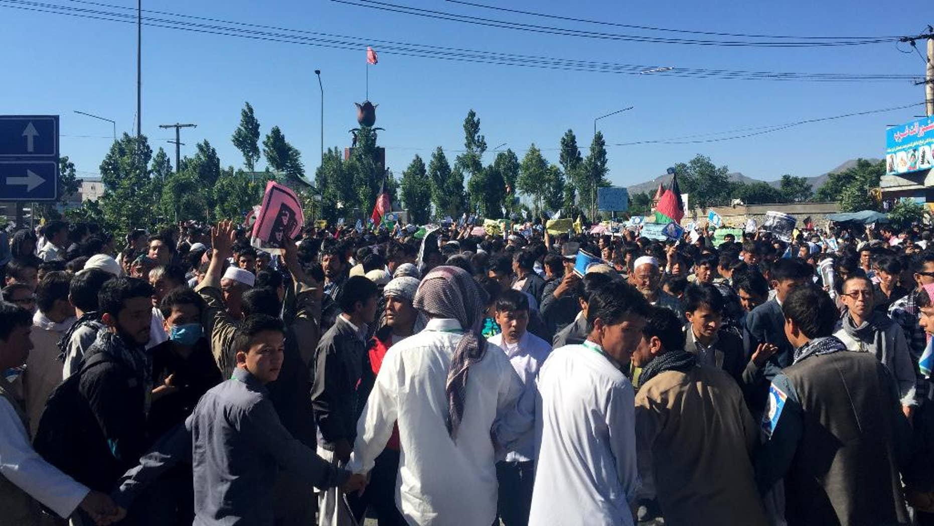 Hazara demonstrators gather to start marching toward the center of Kabul.